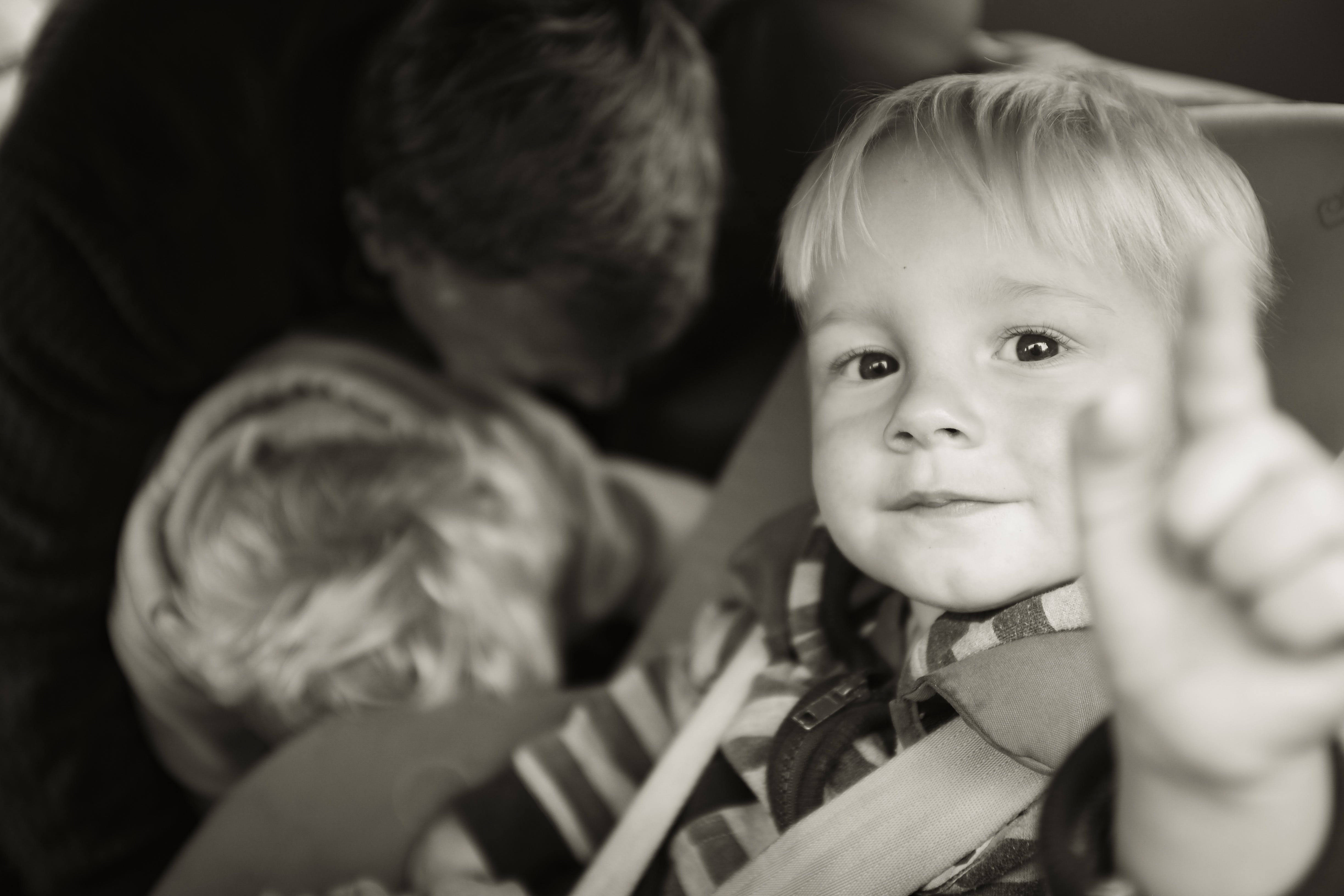 Grayscale Photography of Kid Pointing