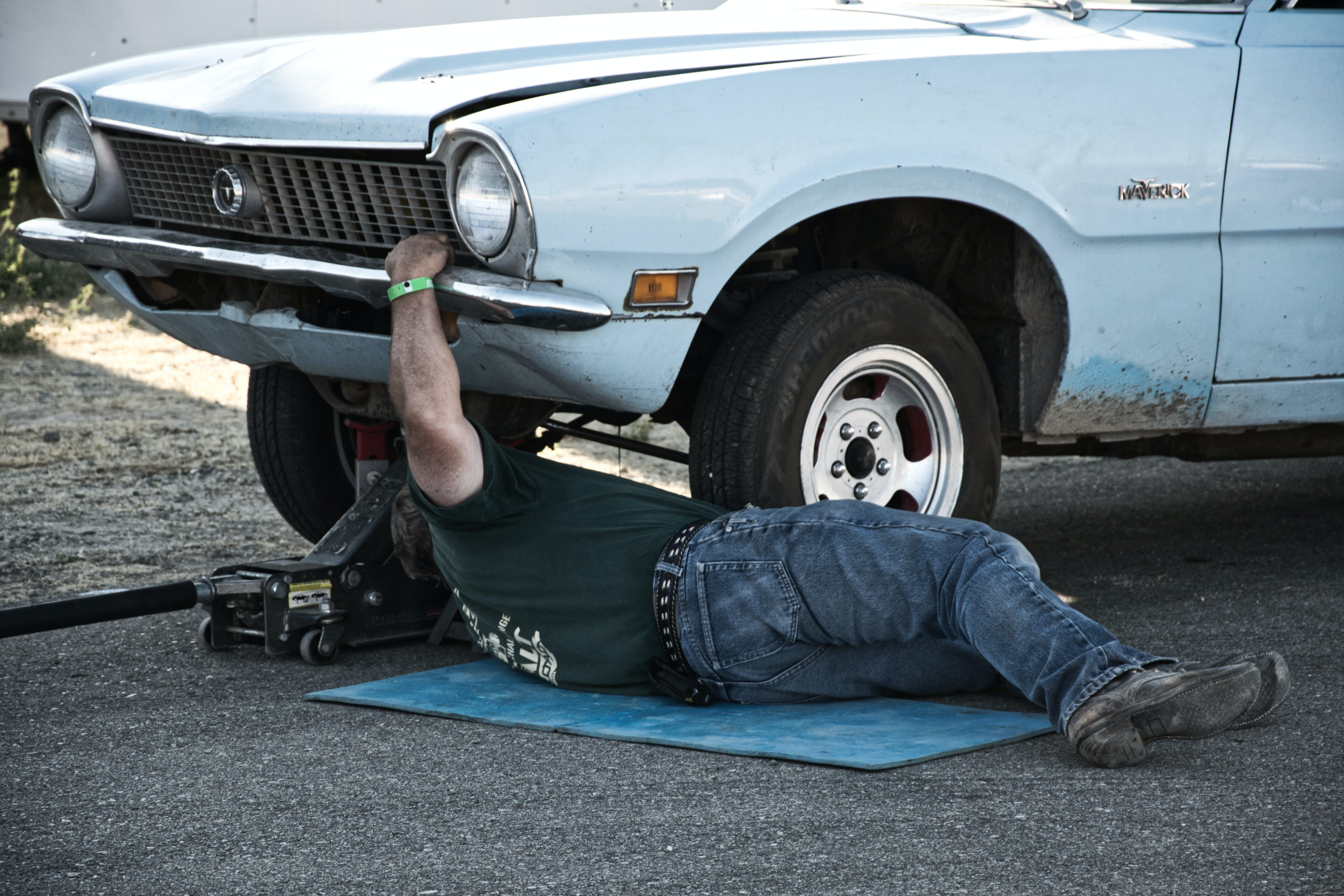 Man Working Under His Car