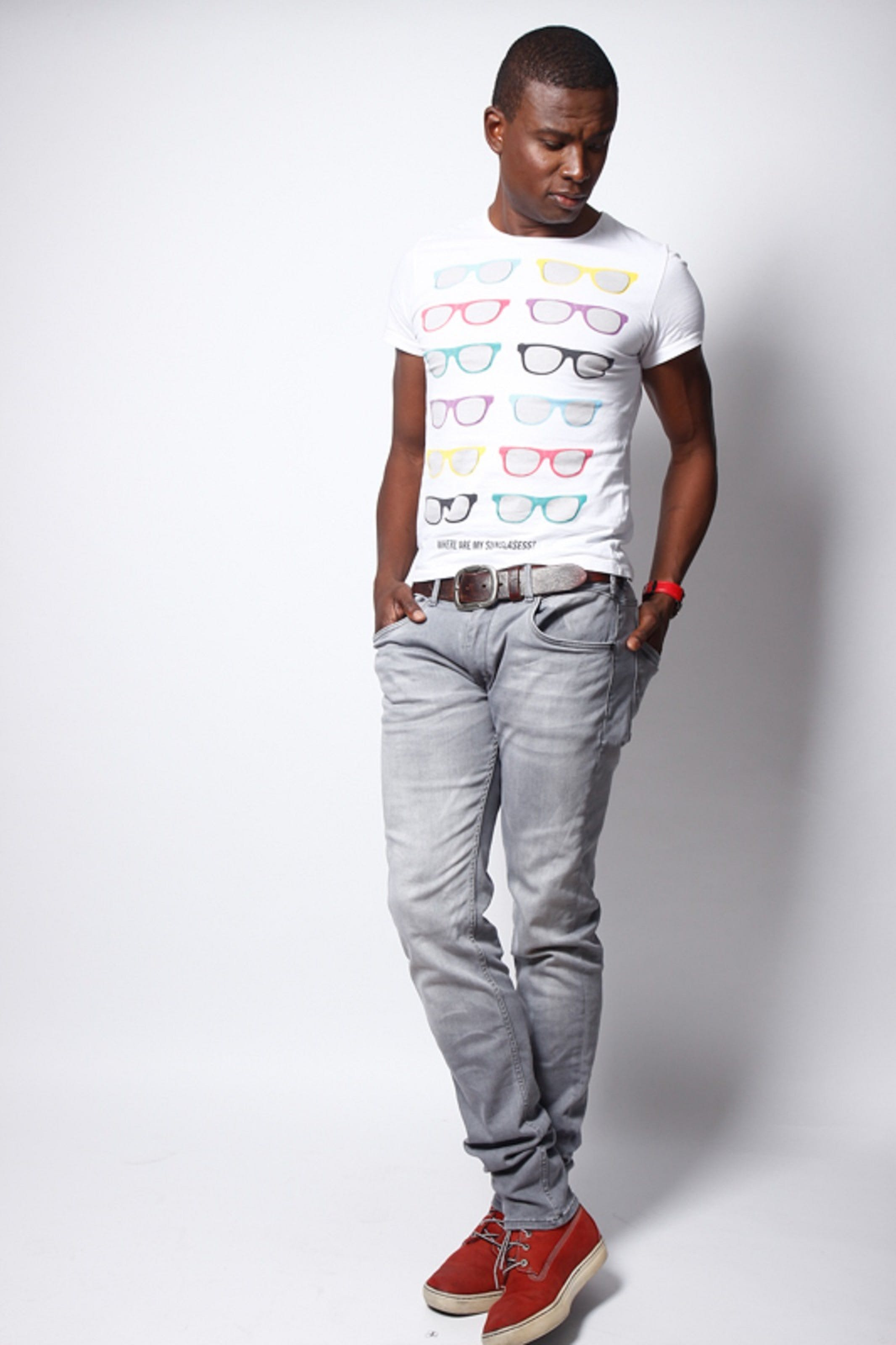 Man Wearing White Crew-neck T-shirt and Gray Pants Outfit