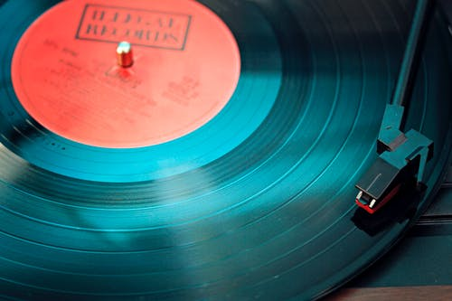 Blue Vinyl Record Playing on Turntable
