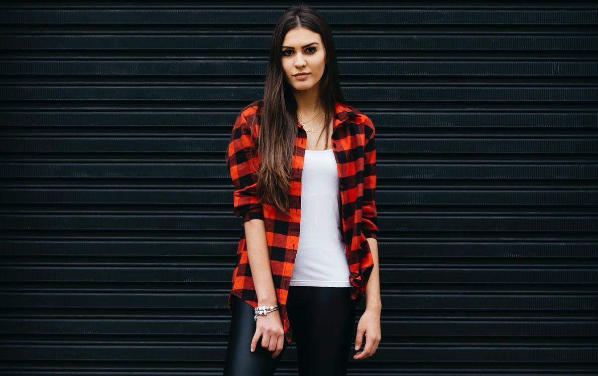 Photo of Woman Wearing Red and Black Checkered Shirt