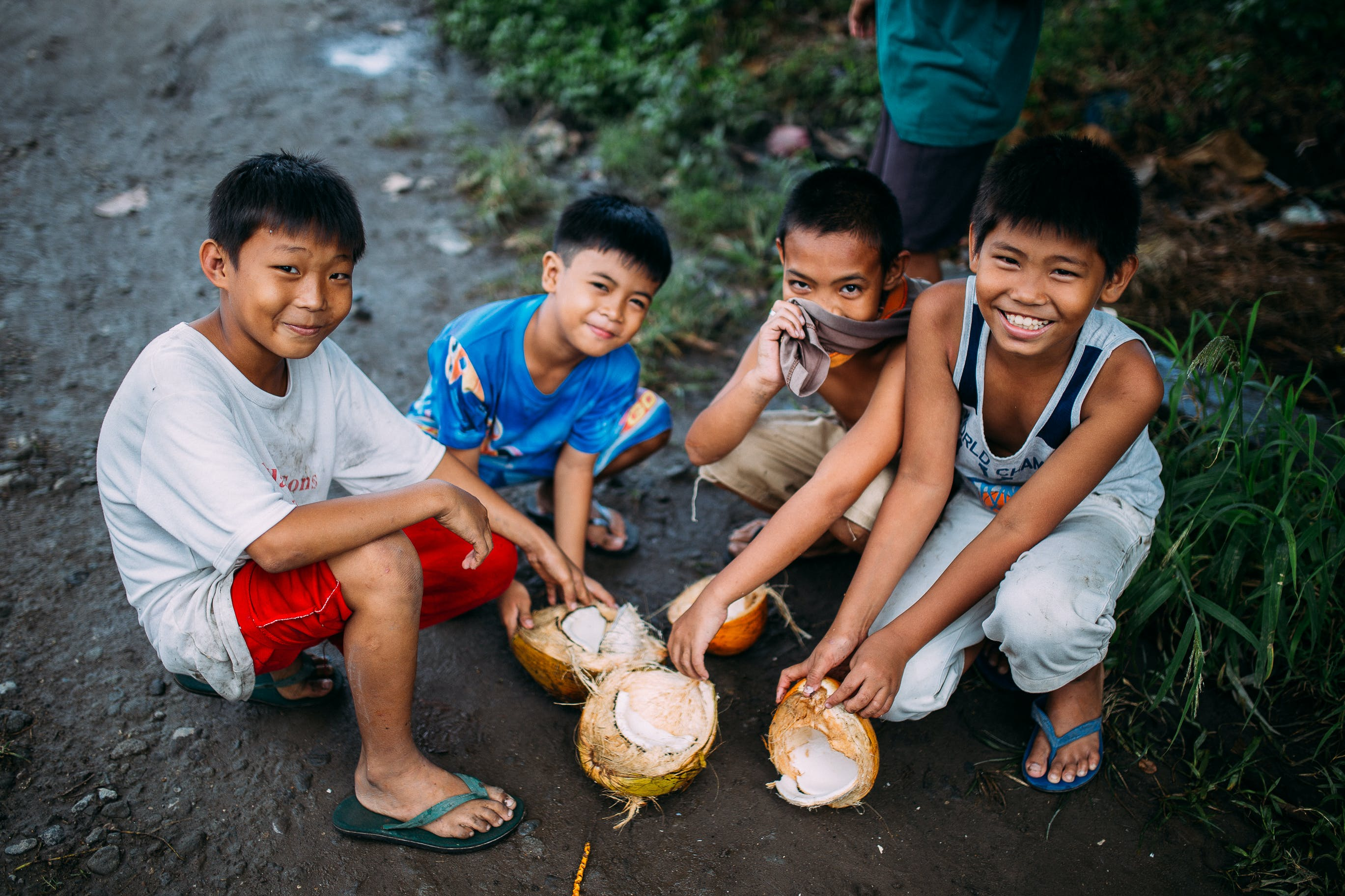 Four Boys Holding Coconut Shell