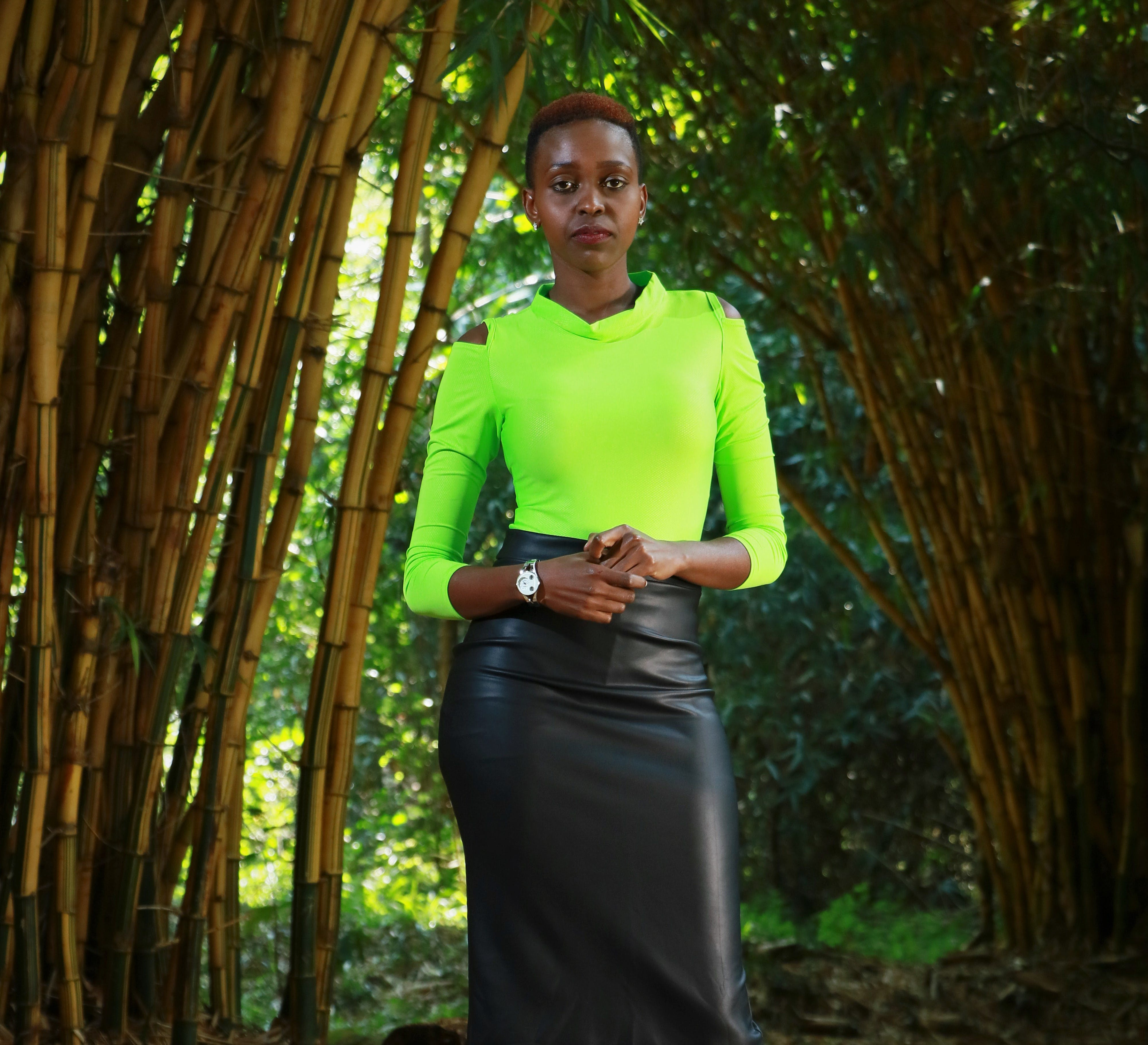 Woman Standing Beside Bamboo Trees