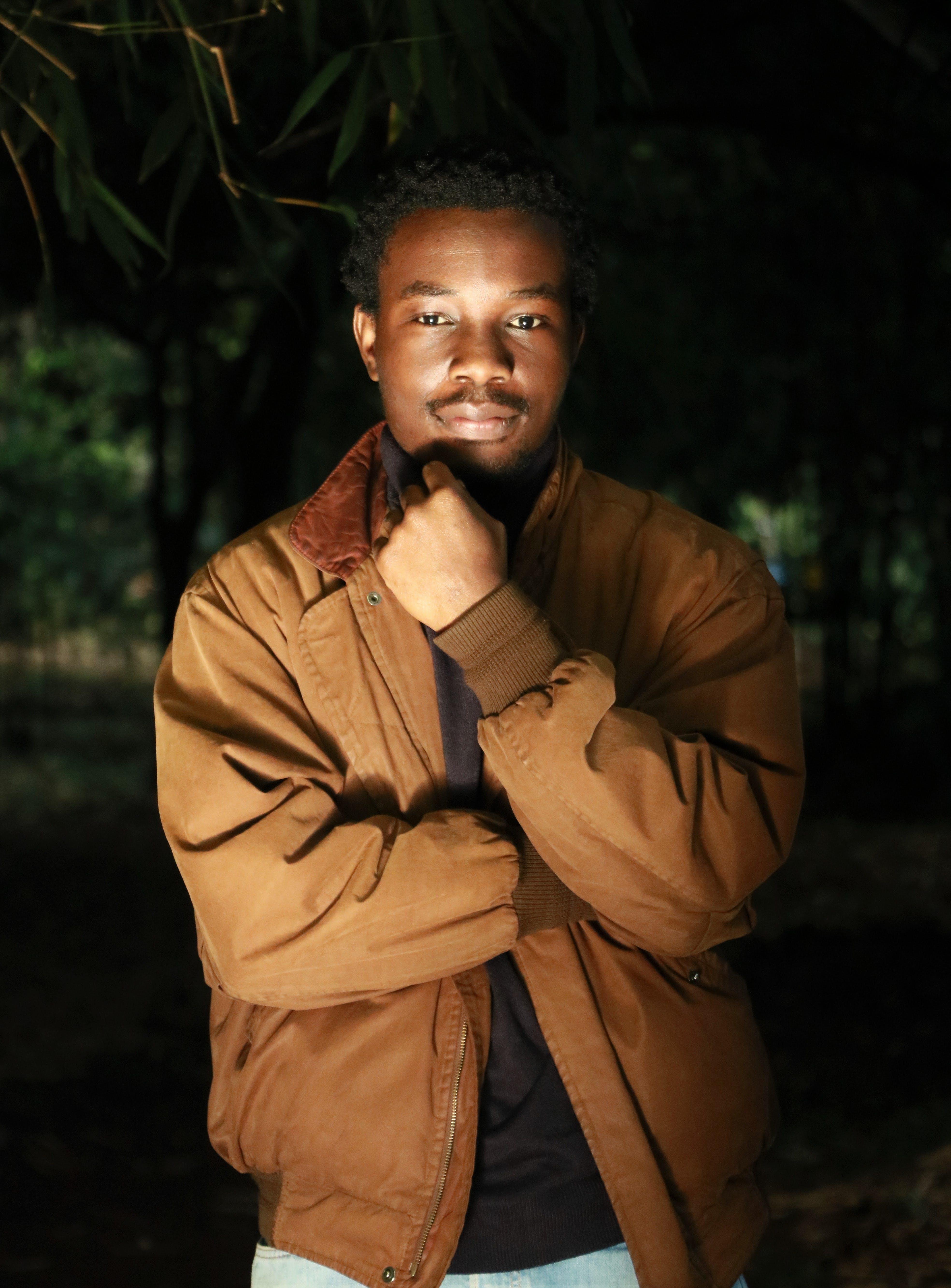 Man Wearing Brown Zip-up Jacket