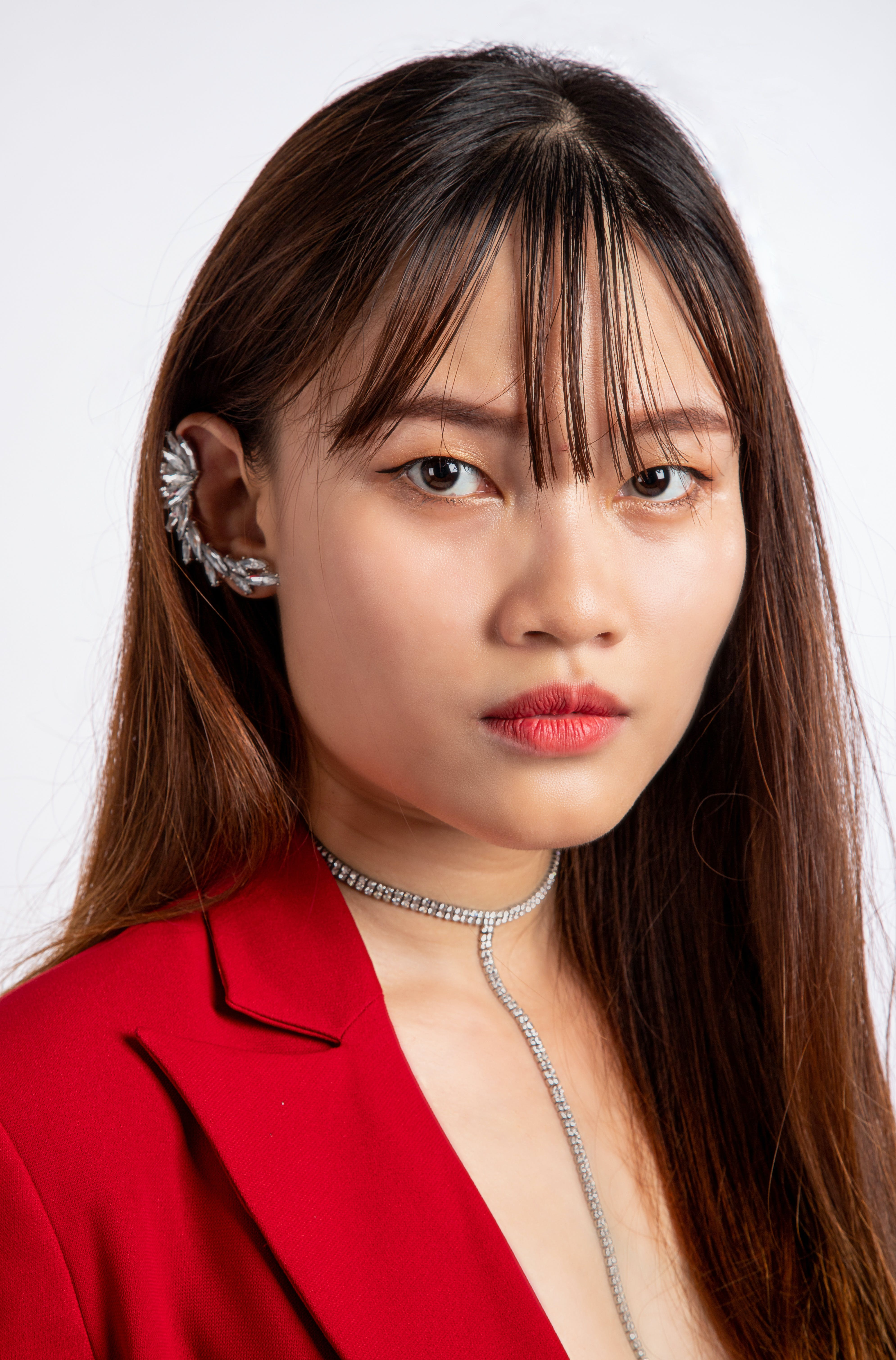 Woman Wearing Necklace and Earring