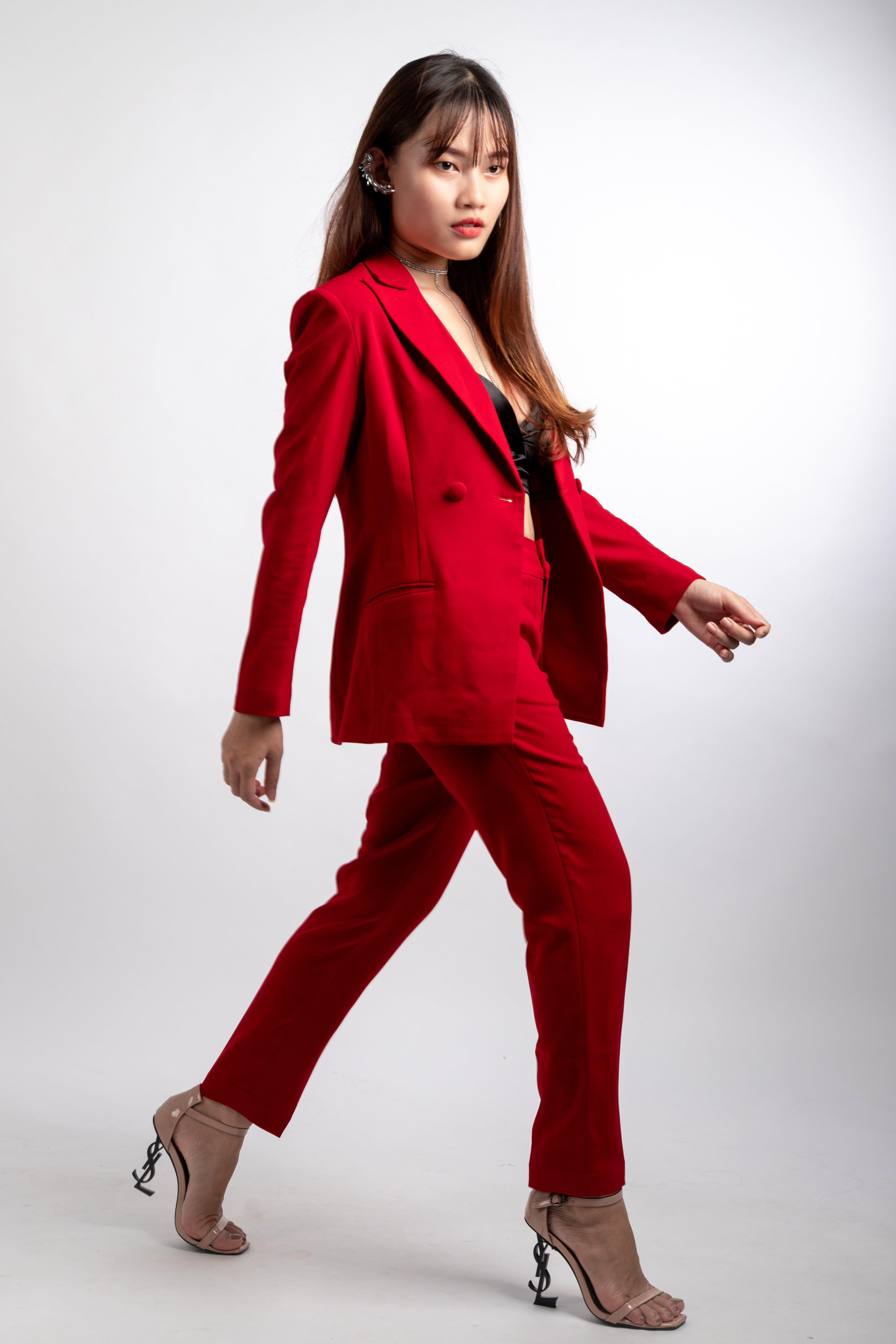 Woman Wearing Red Blazer and Dress Pants