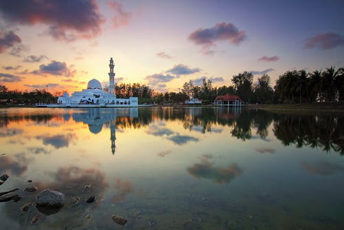 White Mosque Near Body of Water