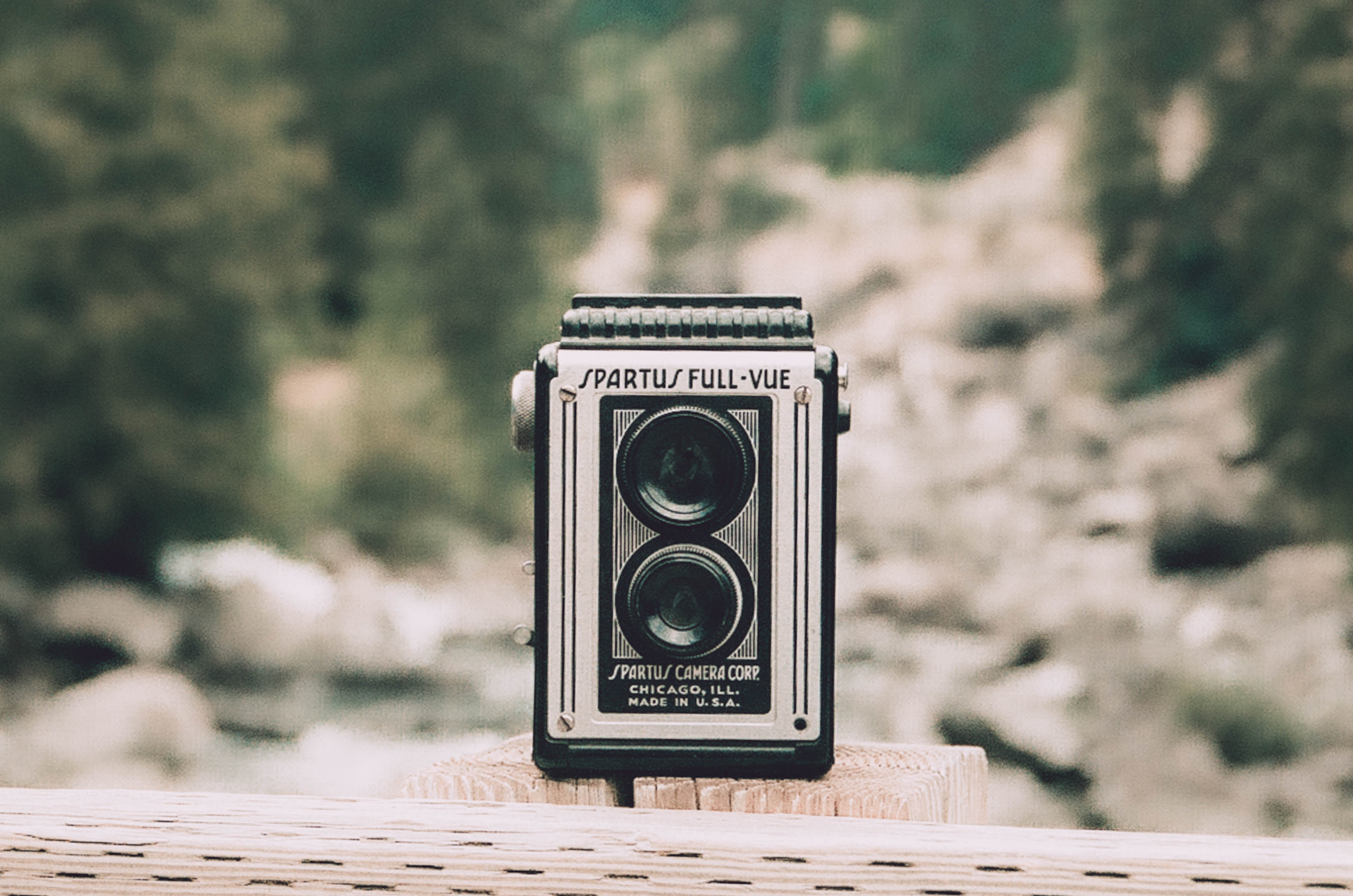 Person Showing Vintage Gray and Black Camera