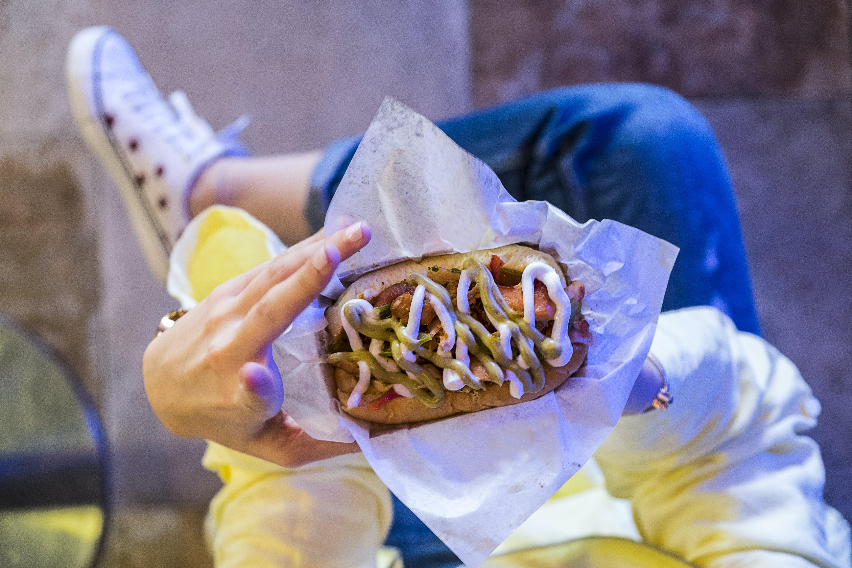 Woman Holding Burger