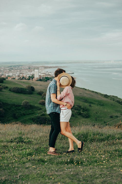 Photo of Woman and Man Hugging While Standing on Grass Bumble Algorithm