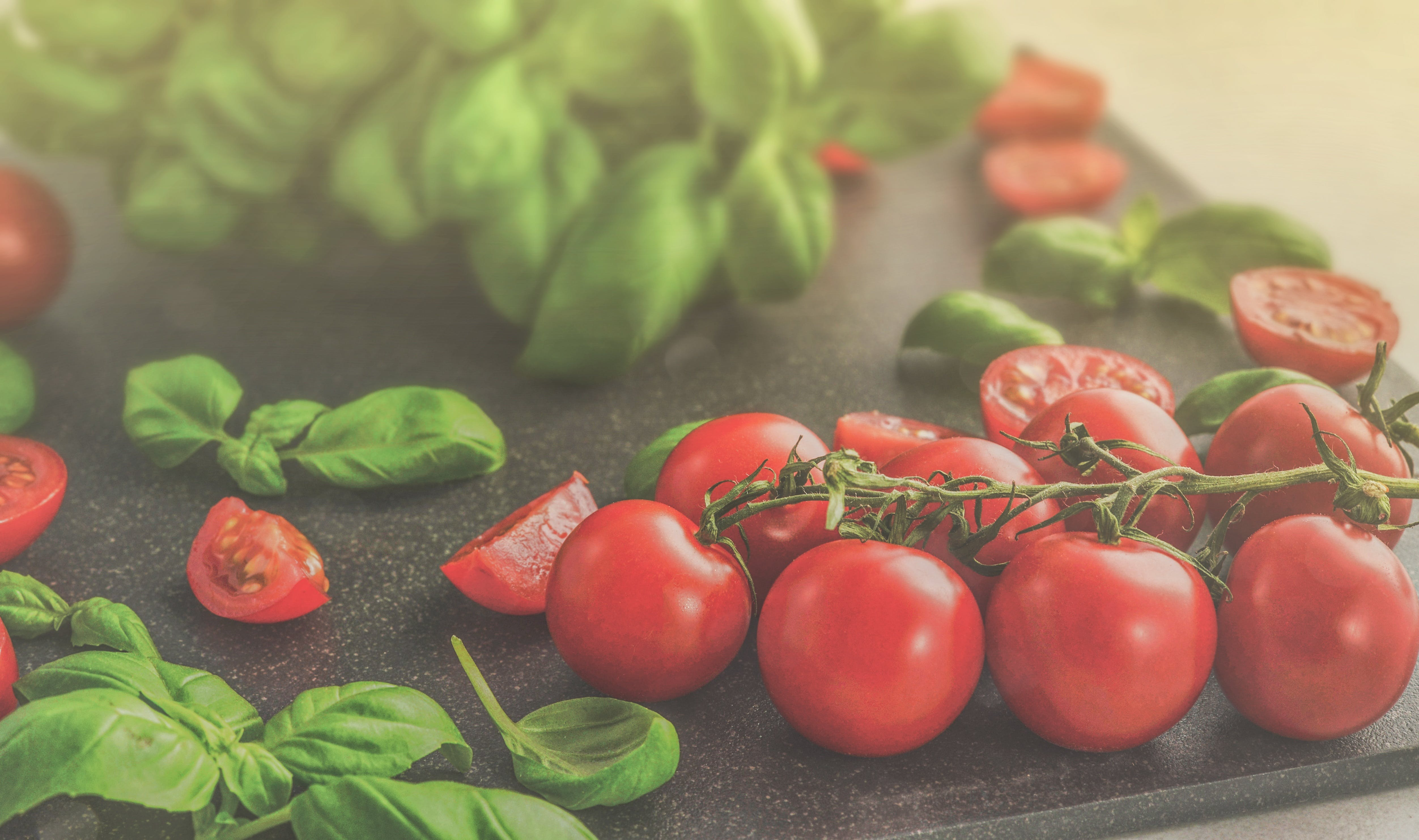 Photo of Tomatoes Near Green Leaves