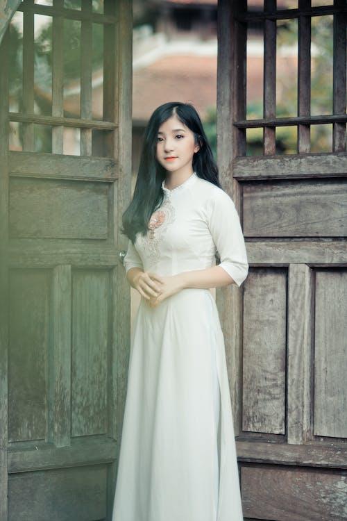 Woman Standing Between Doors