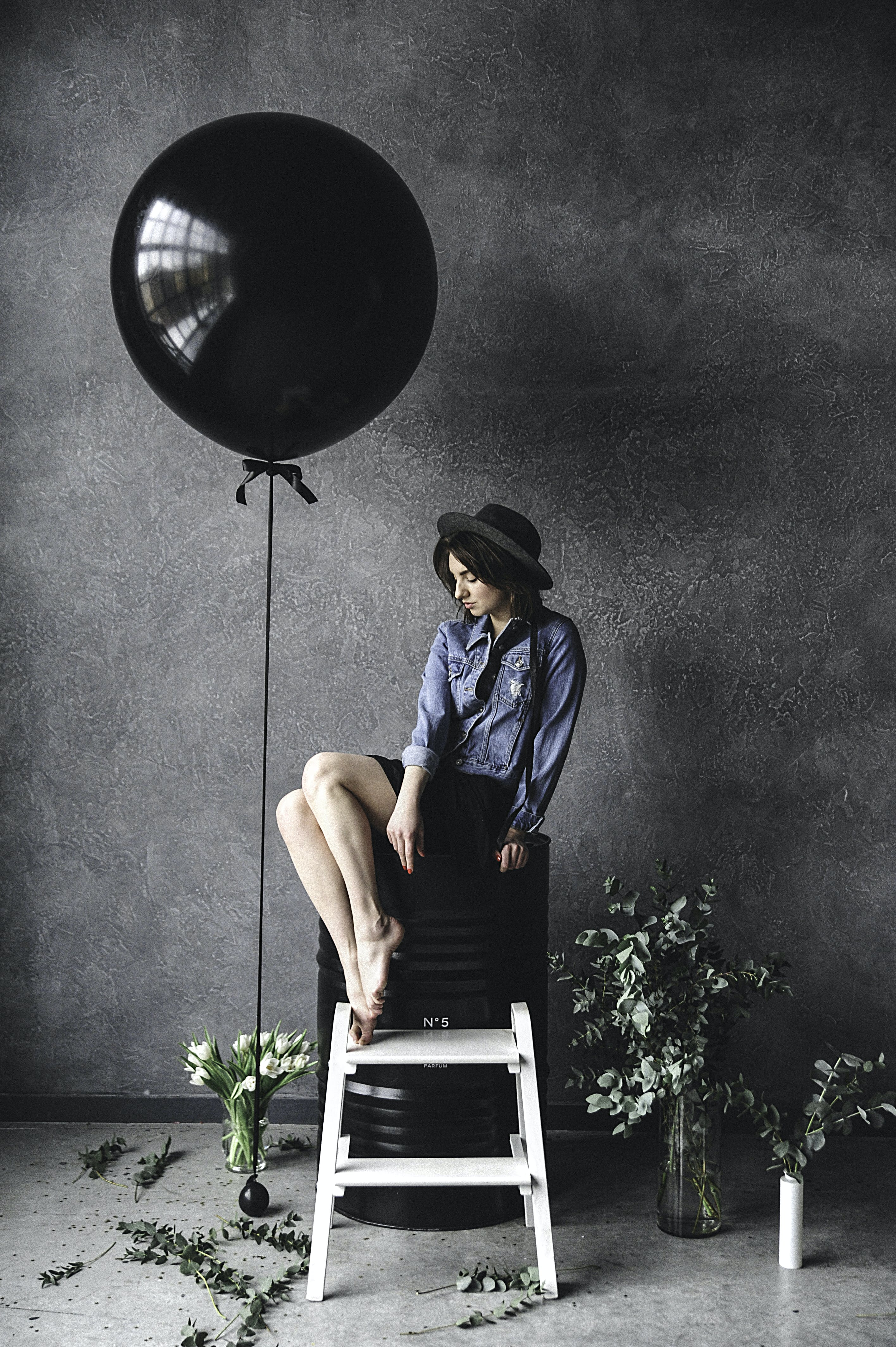 Woman Sitting on Chair Beside Balloon