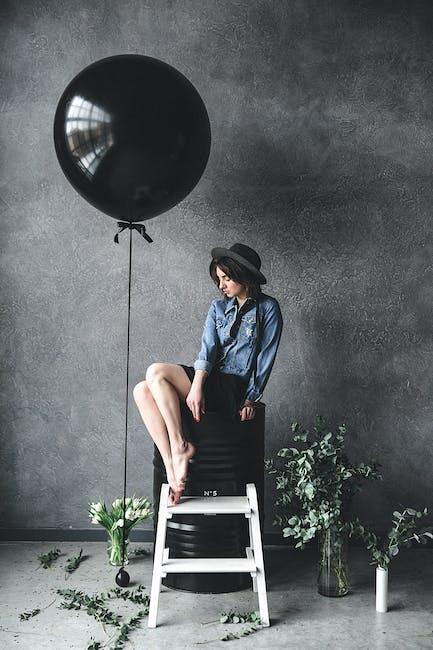 Woman sitting on chair beside balloon