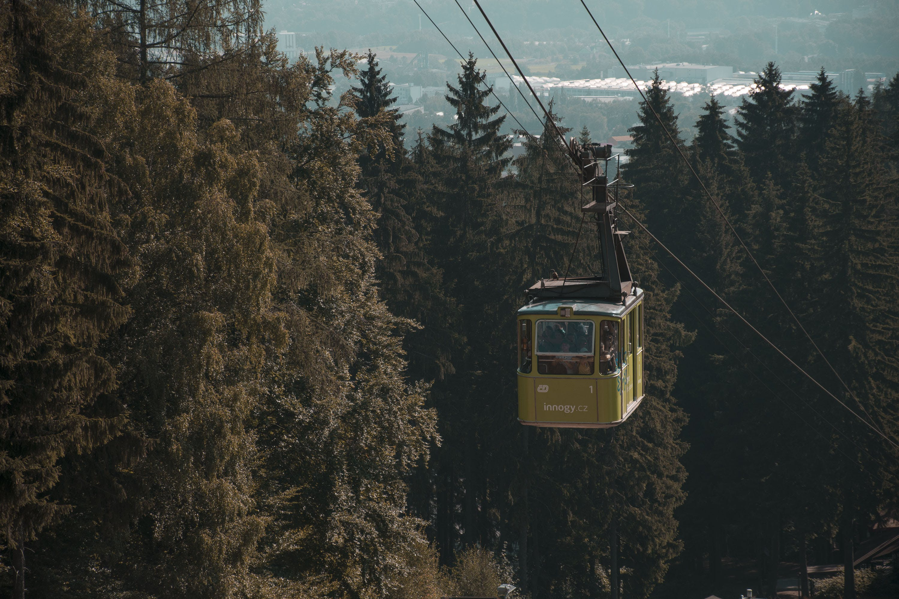 Close-up Photo of Yellow Cable Car