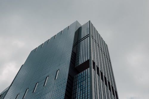 Gray Curtain-wall Building Under Cloudy Sky