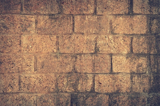 Brown and Black Brick Wall Close Up Shot Photography