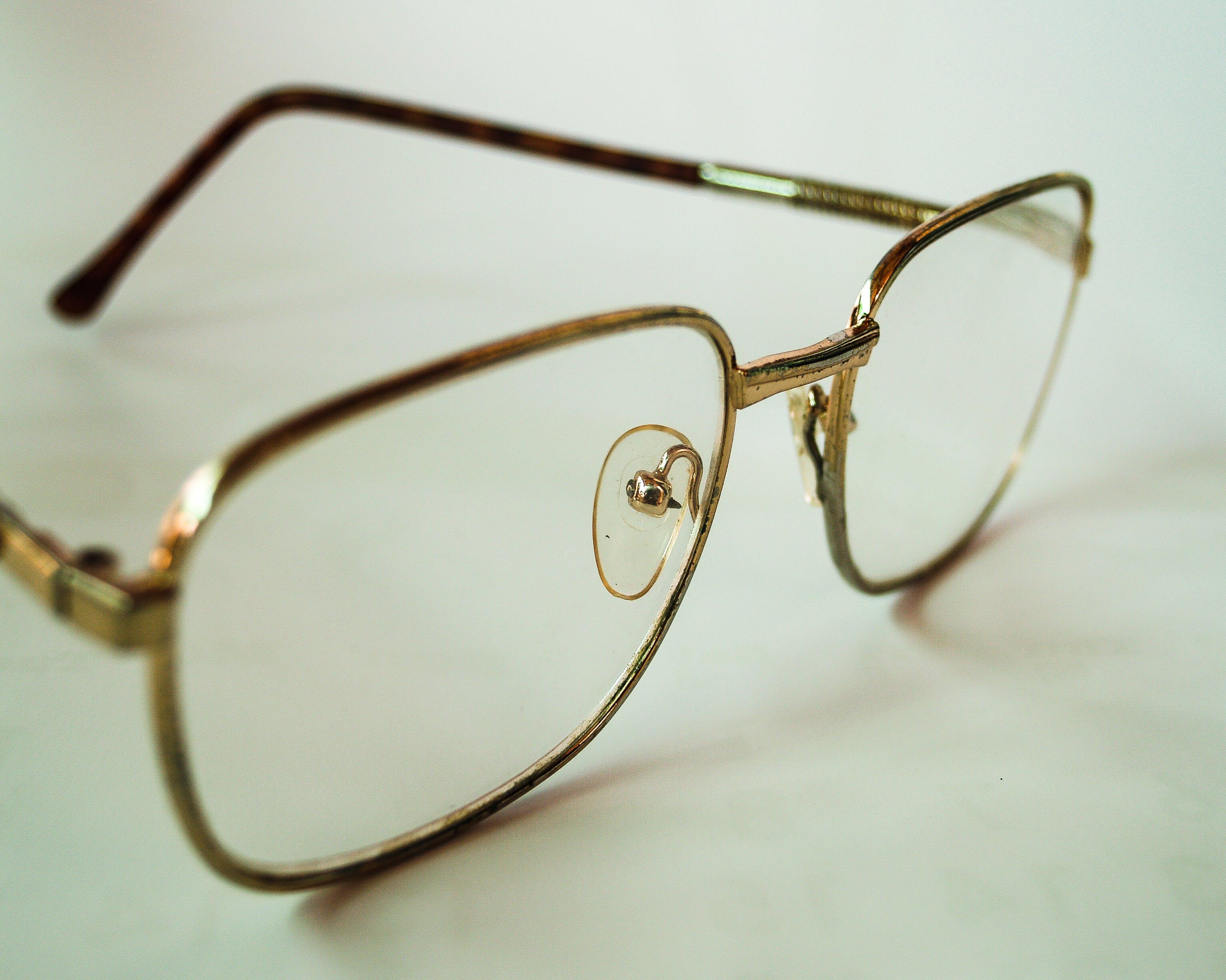 Close-up Photo of Yellow Frame Eyeglasses