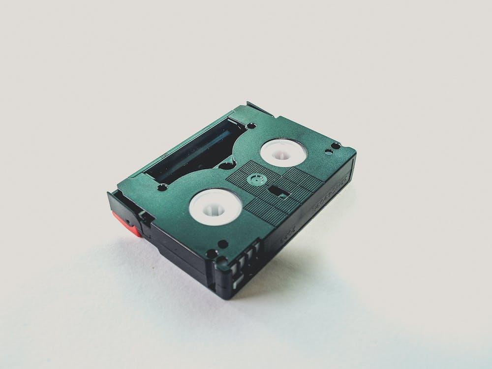 Black Cassette Tape on White Wooden Table