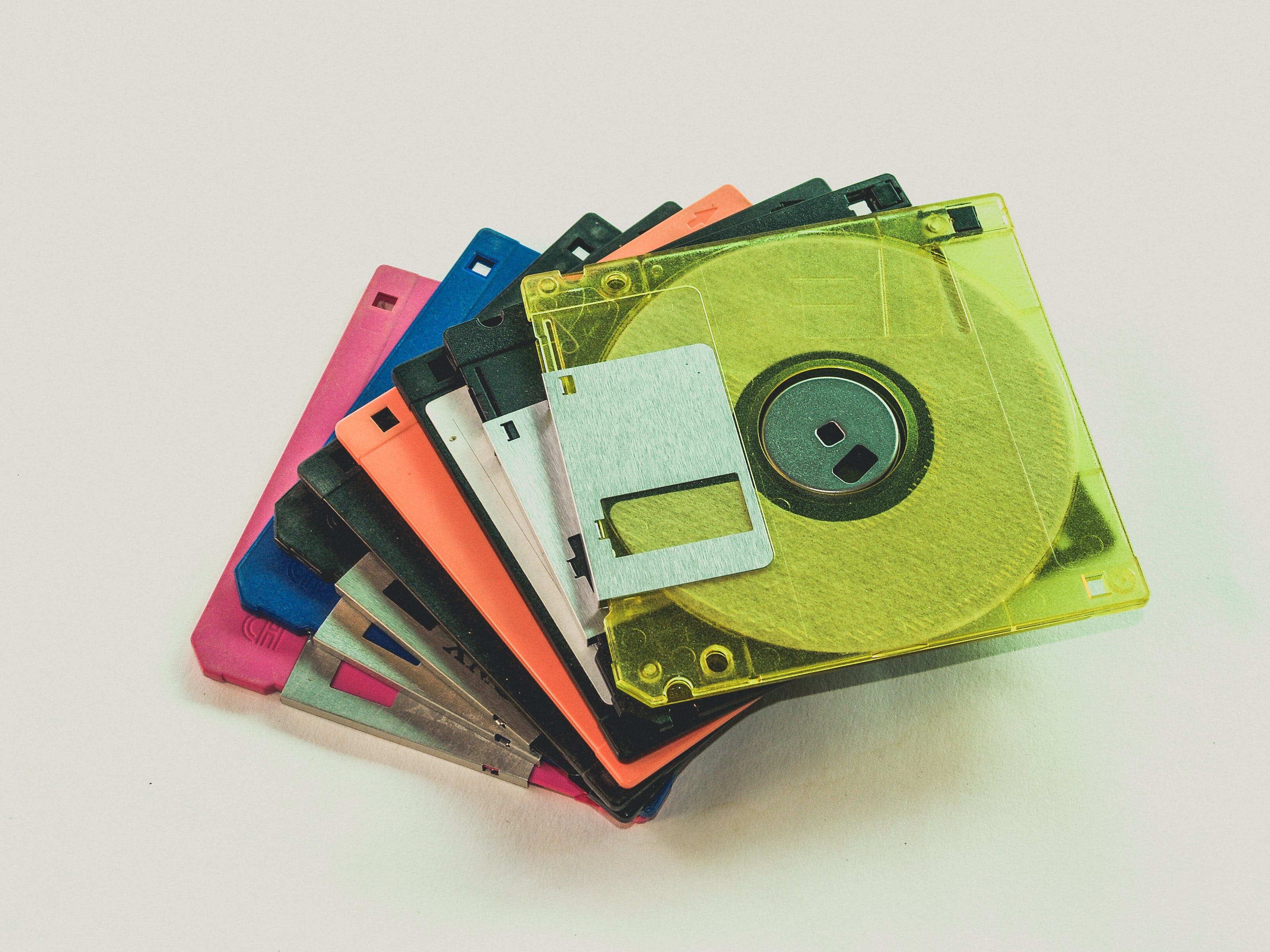 Floppy Disk Lot on White Surface