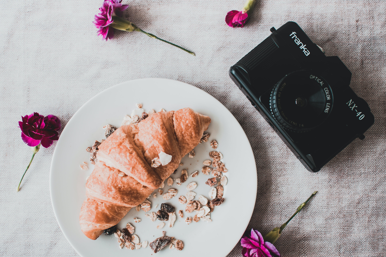 Black Franka Dslr Camera Beside Croissant