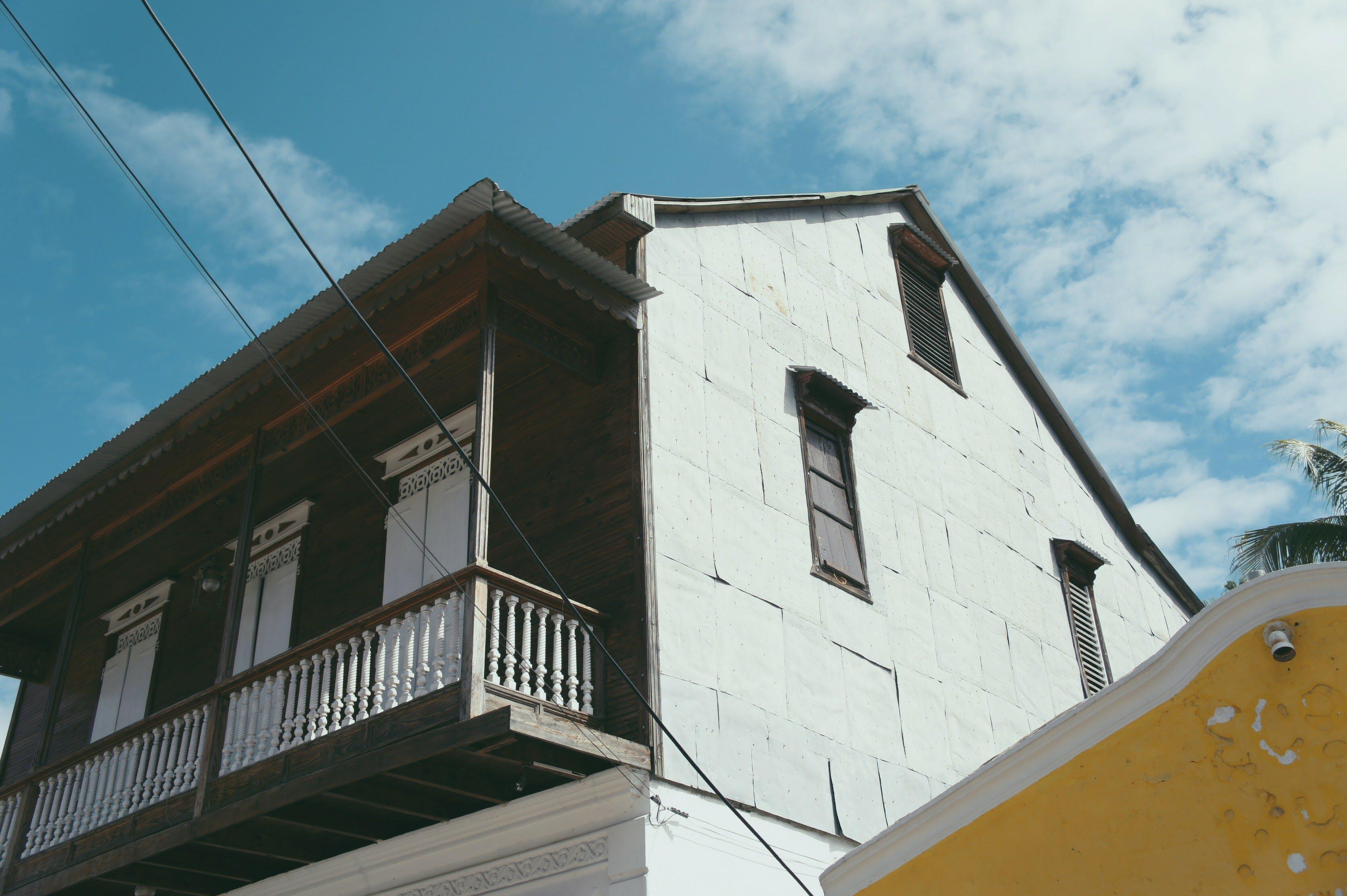 White and Black Concrete 2-storey House Under Blue Sky
