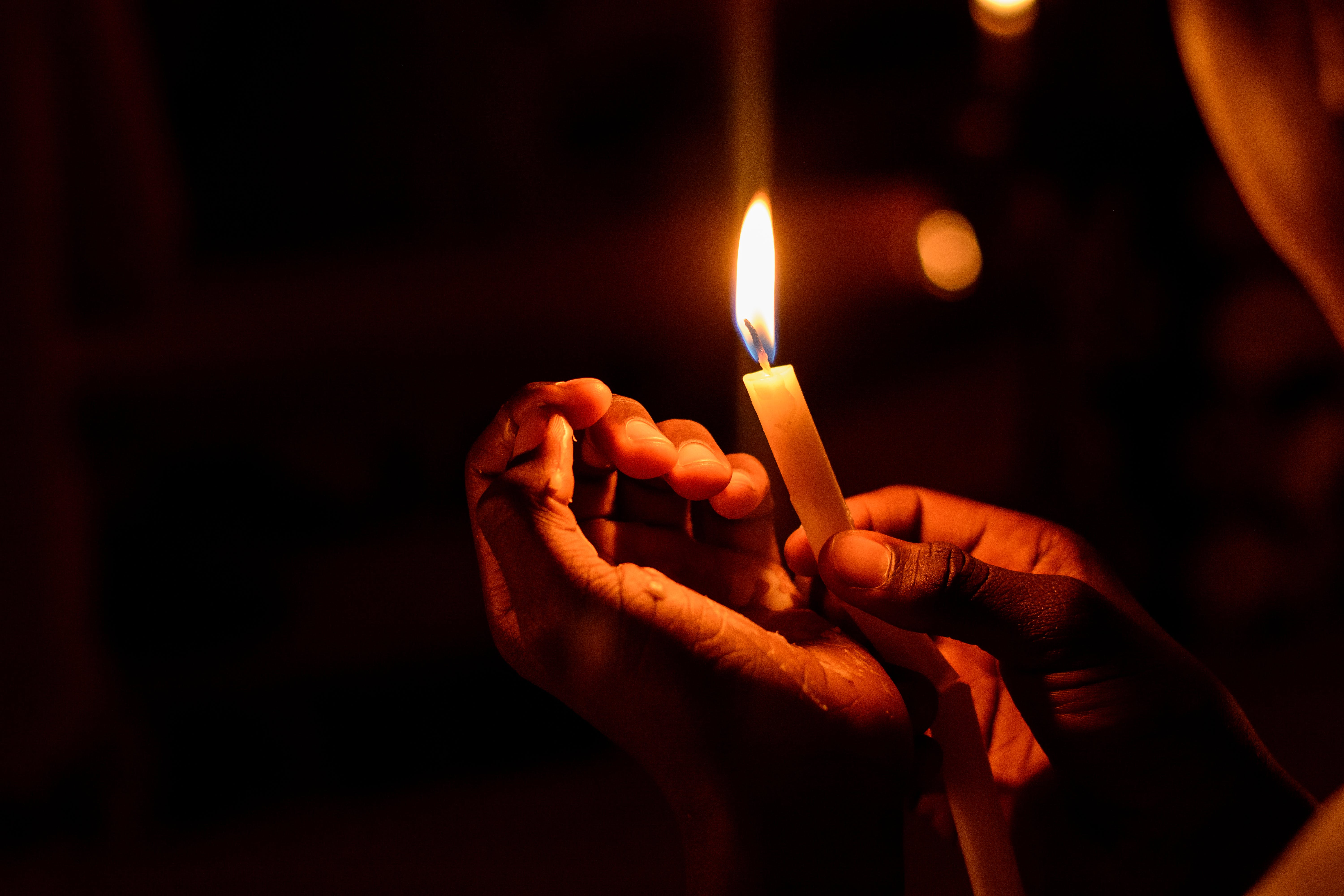 Person Holding Lighted Candle