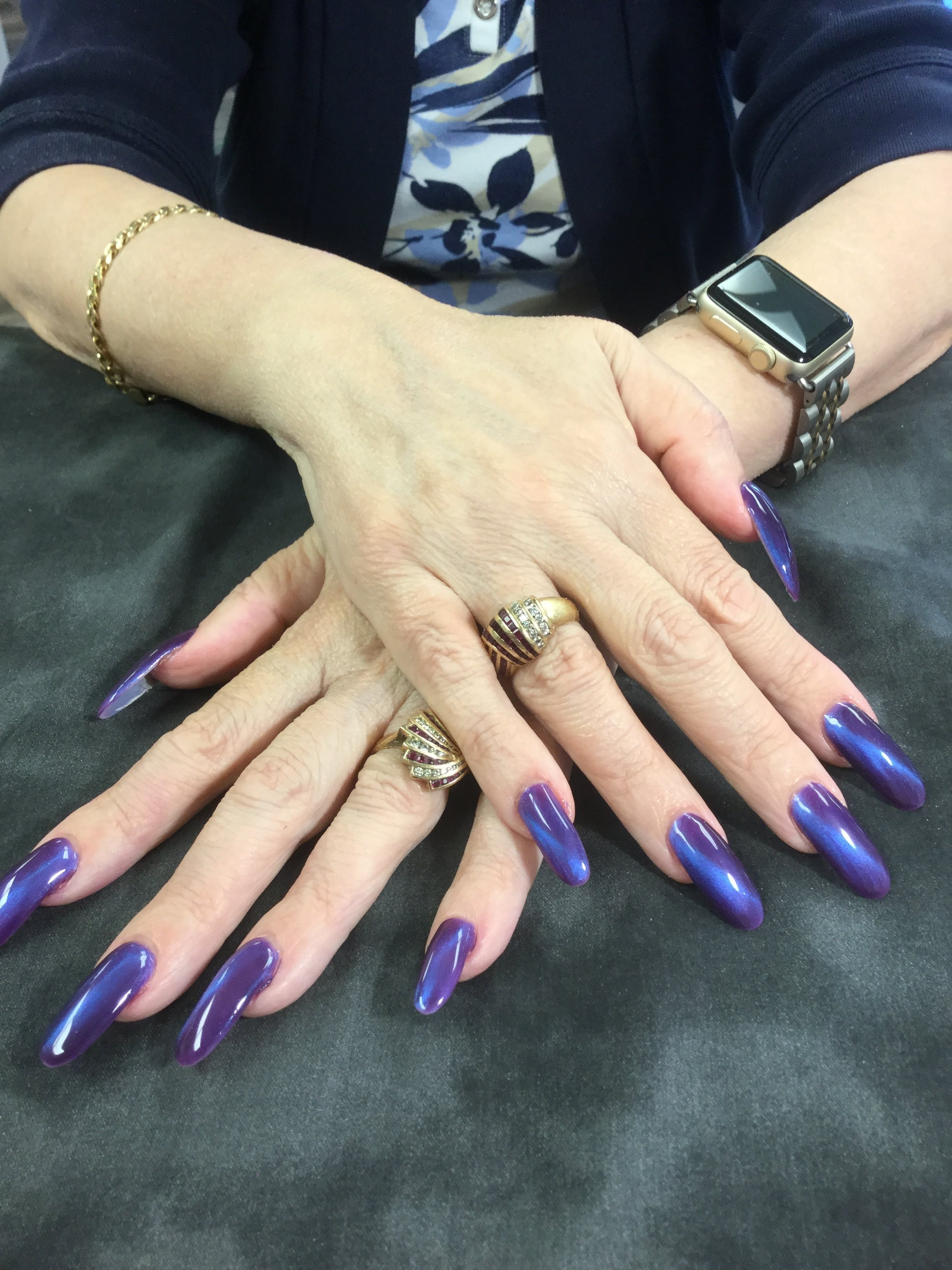 Free stock photo of Tiger eye nails in purple