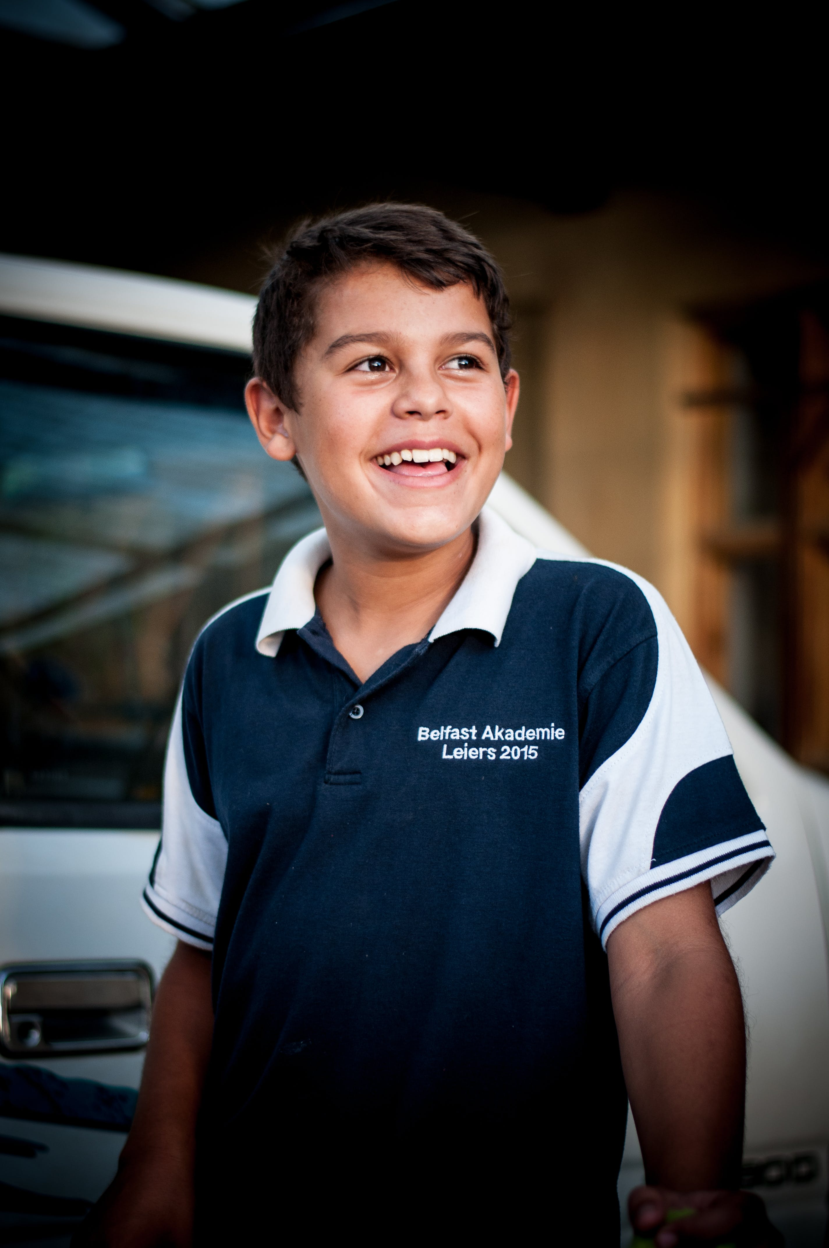Kid Wearing Blue and White Polo Shirt