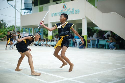 Photo of Boys Sparring With Sword