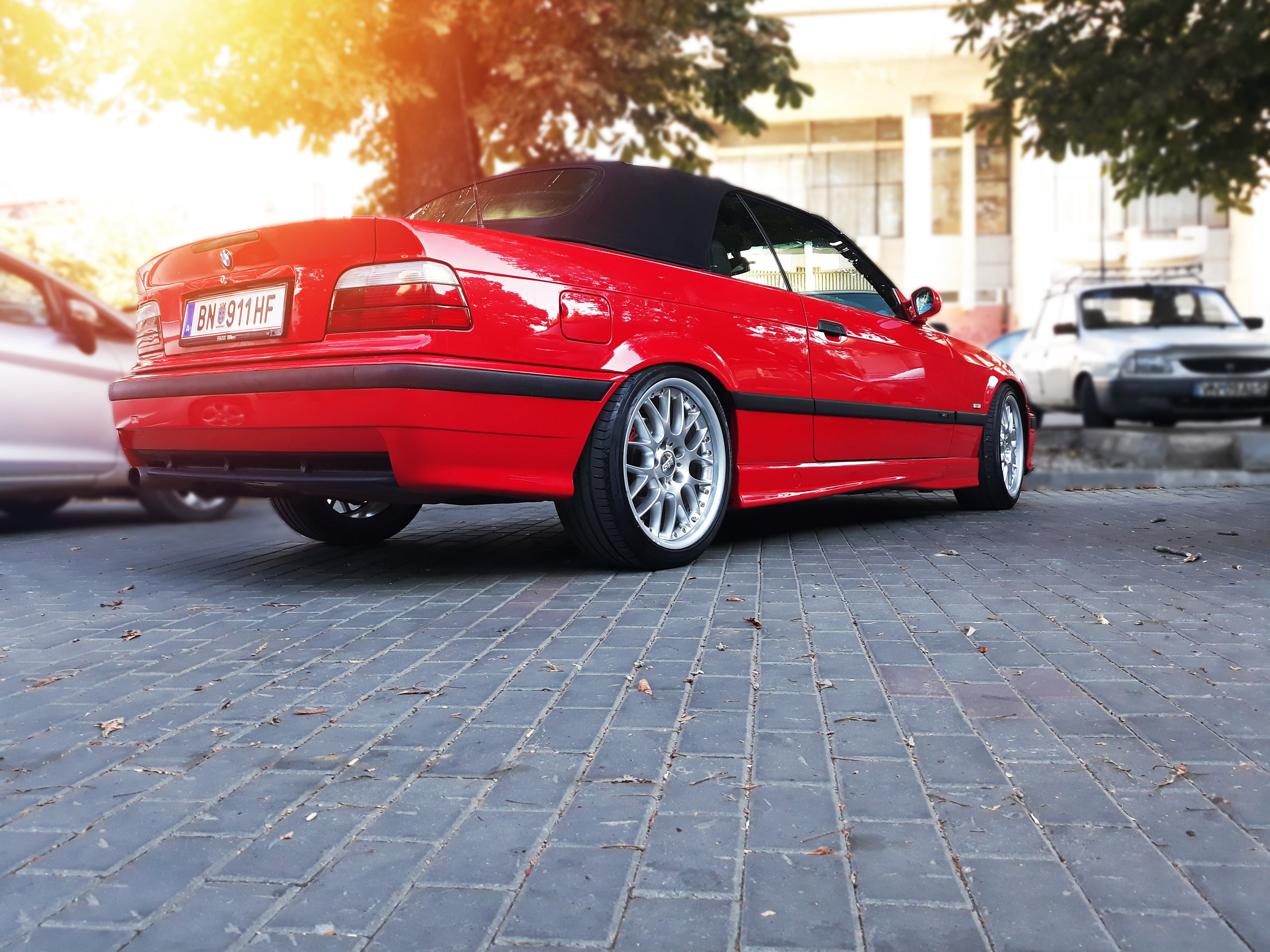 Red Bmw Coupe Parked on Road