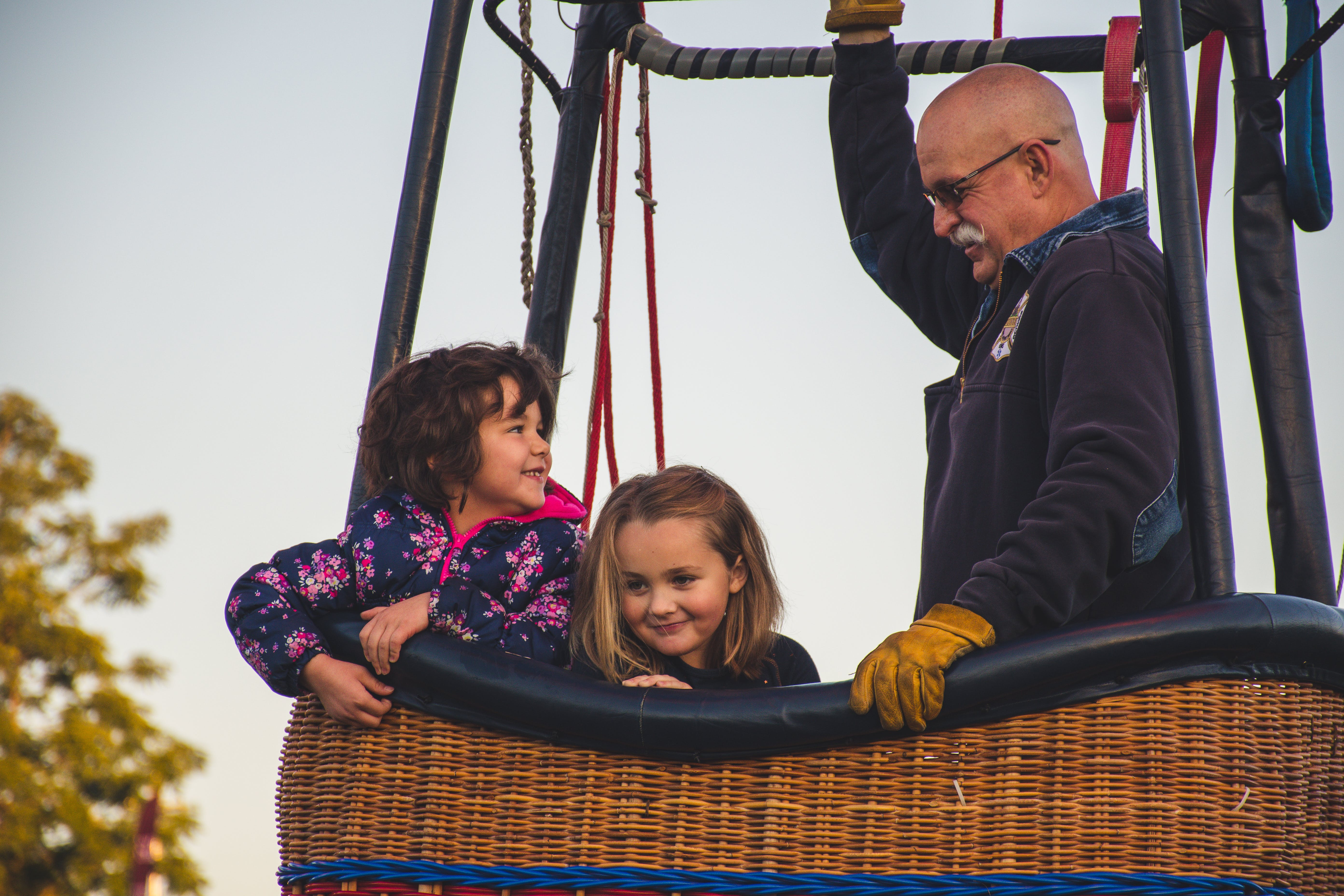 Man and Two Girls Riding on Hot Air Balloon