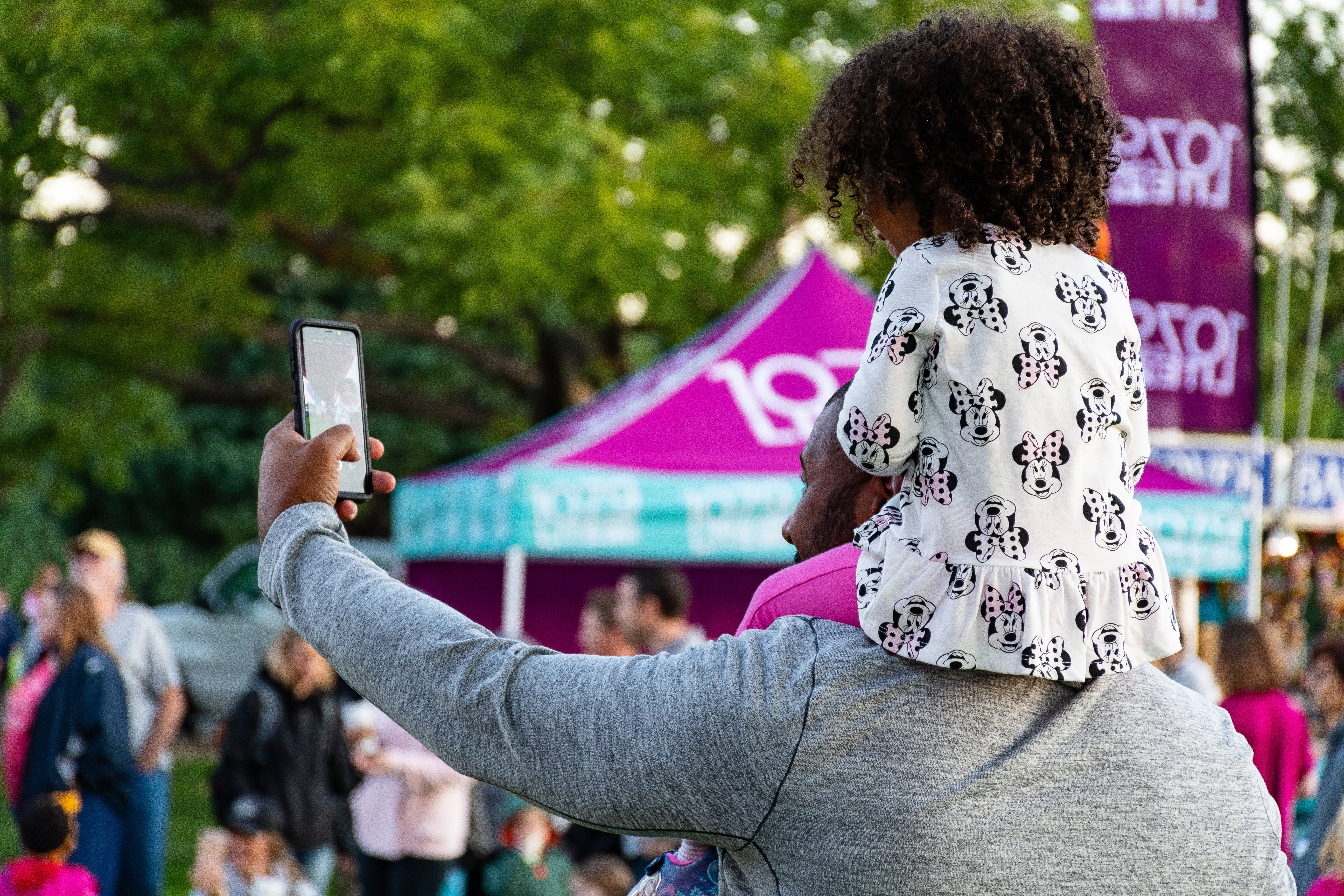 Man Taking Selfie With Girl Riding on Him