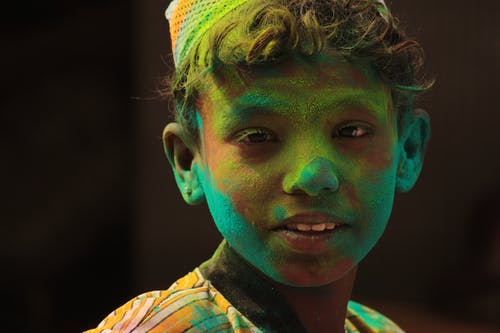 Boy's Face Filled With Green Powder