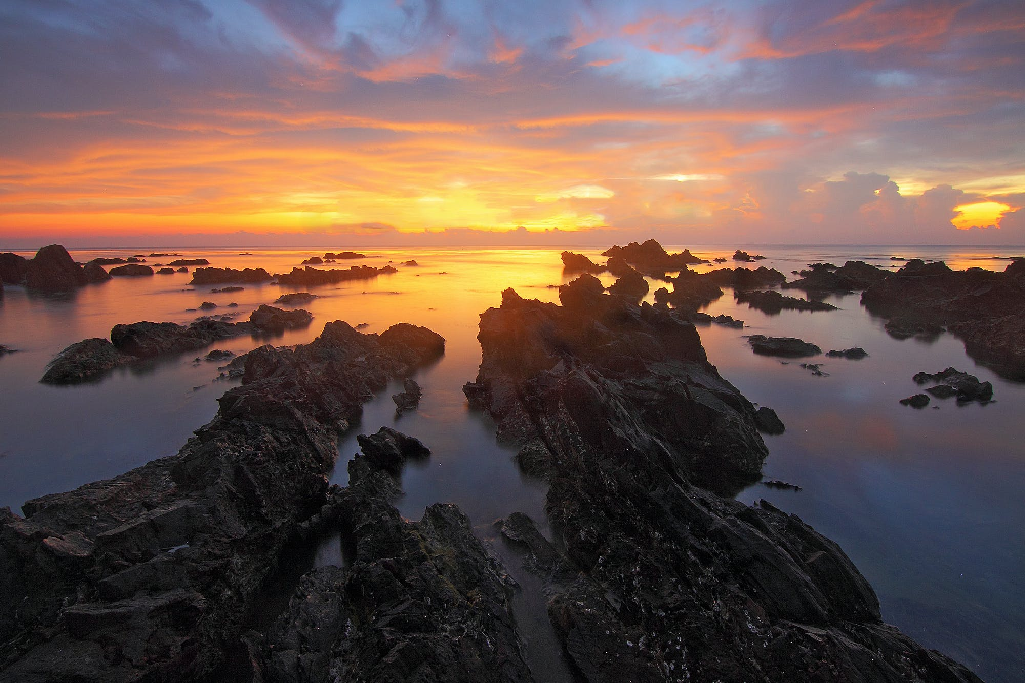 Rocks Near the Body of Water Landscape Photography