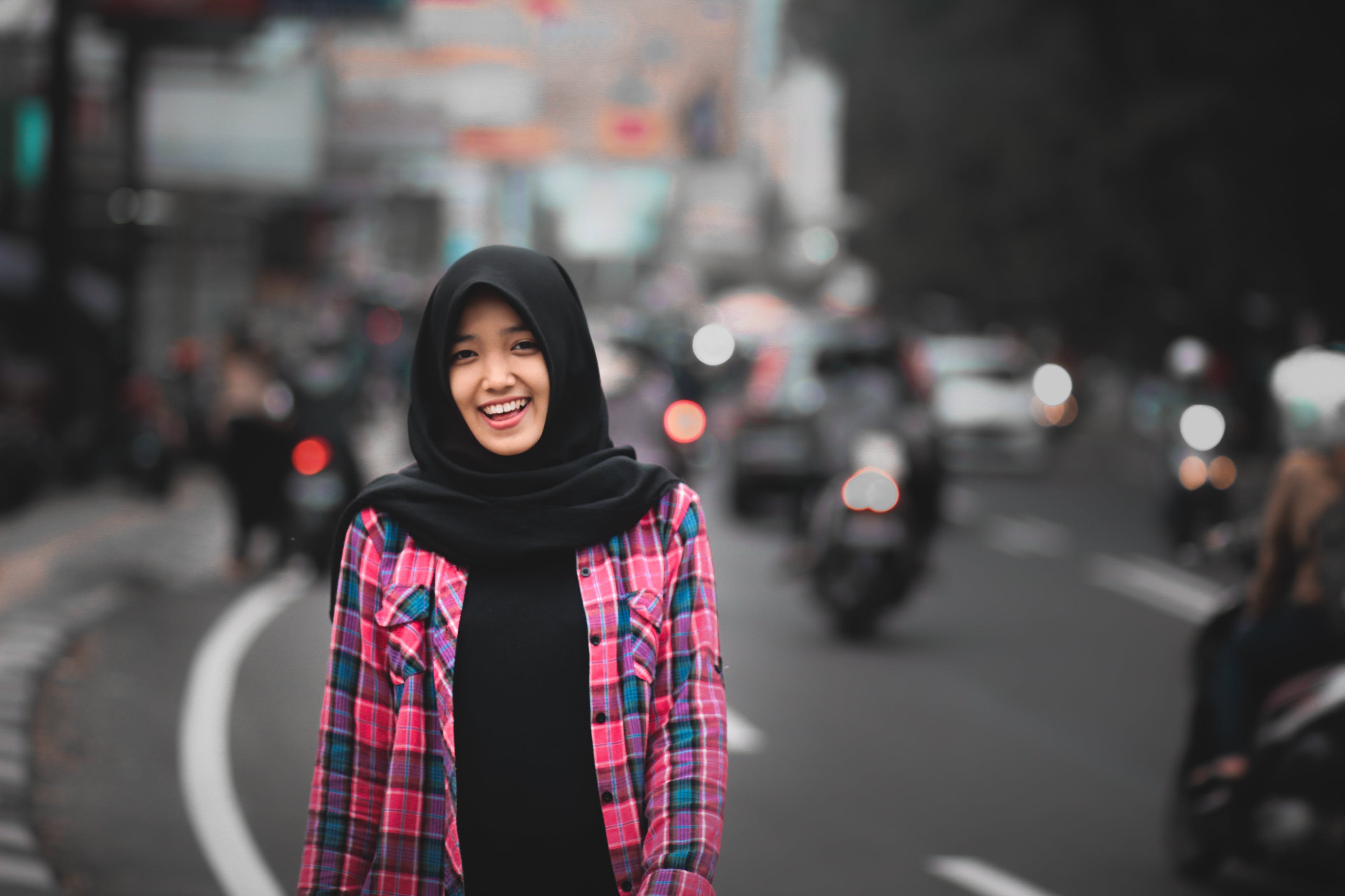 Smiling Woman Standing Beside Road