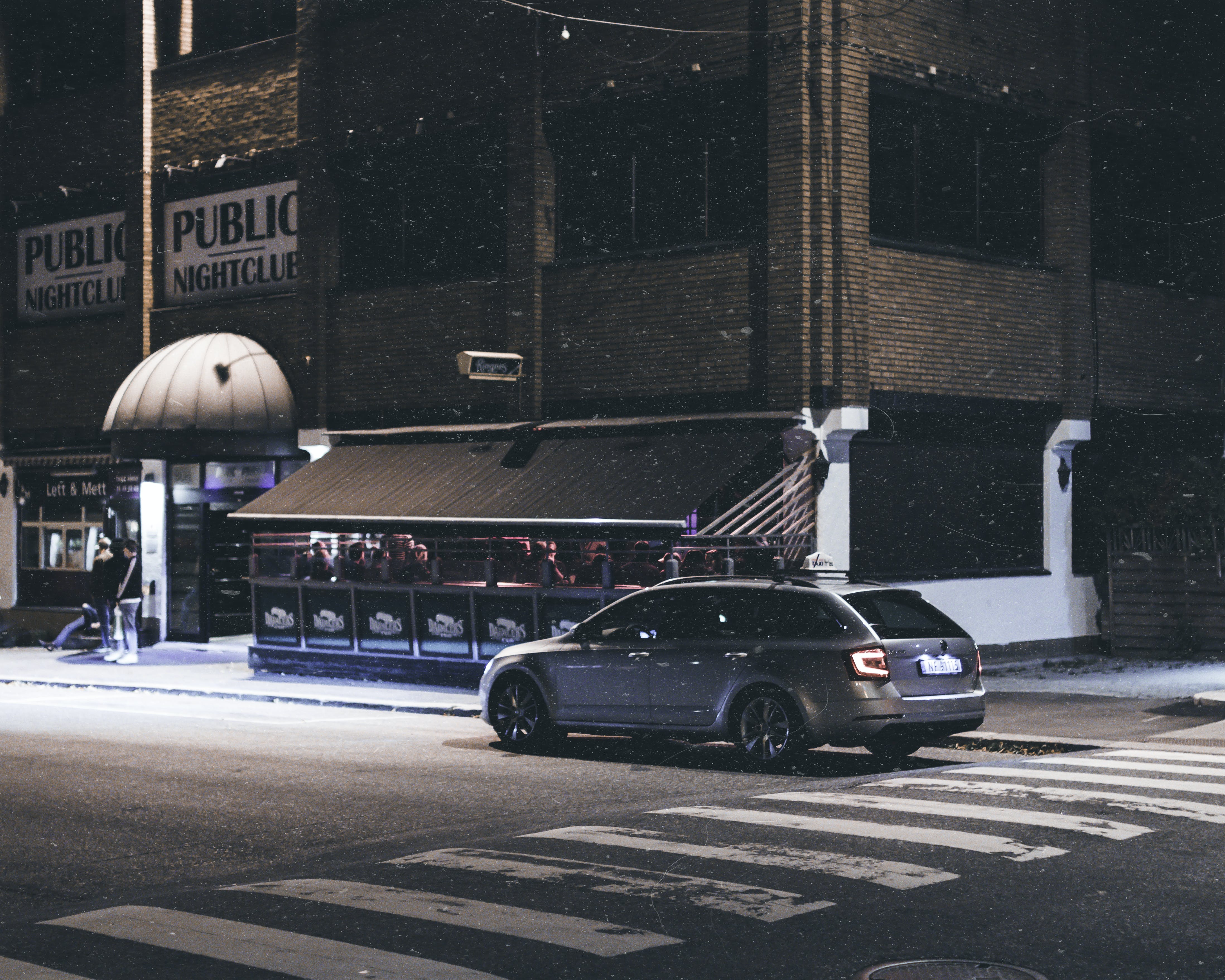 Gray Station Wagon Parked on Road at Night