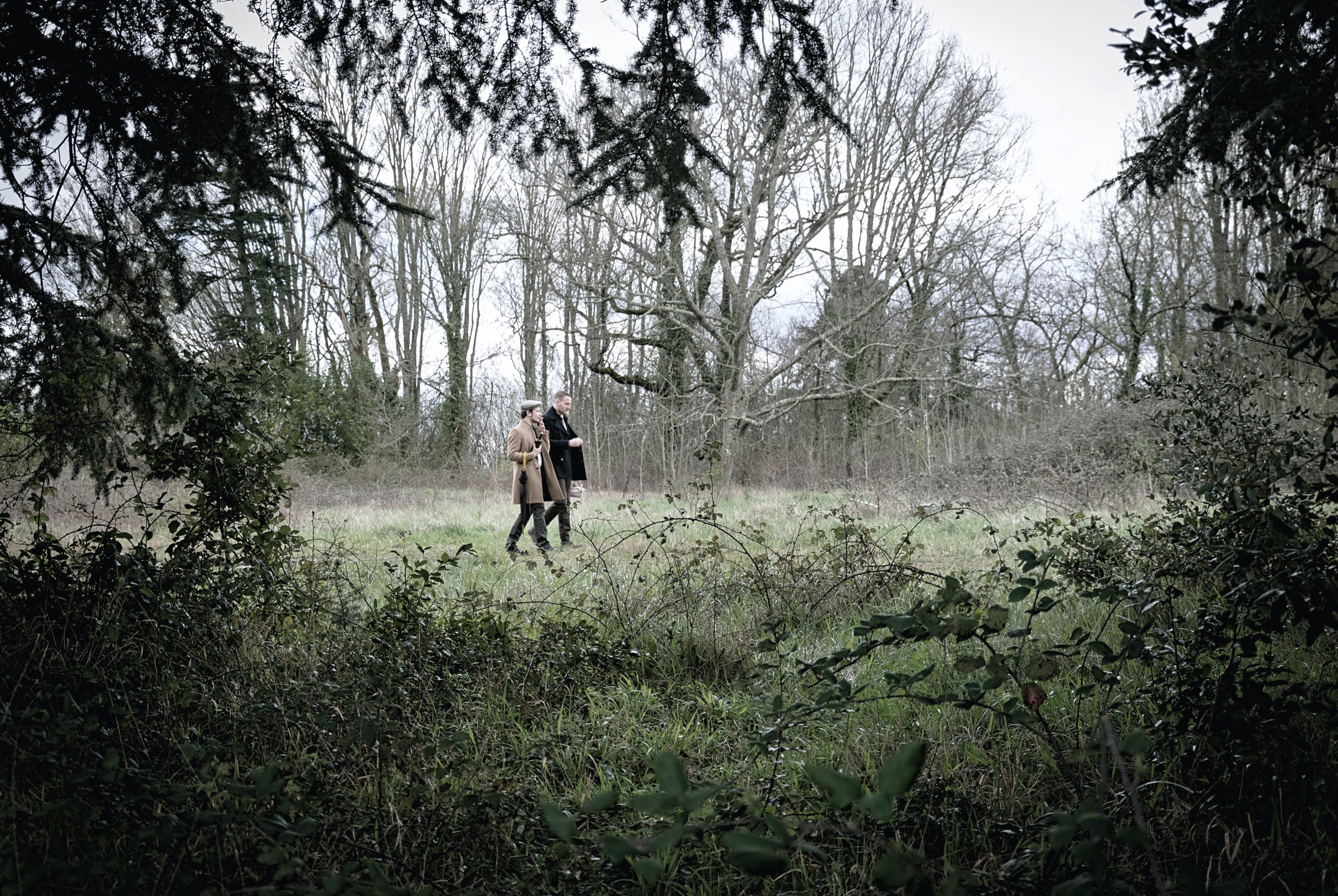 Men Walking on Forest