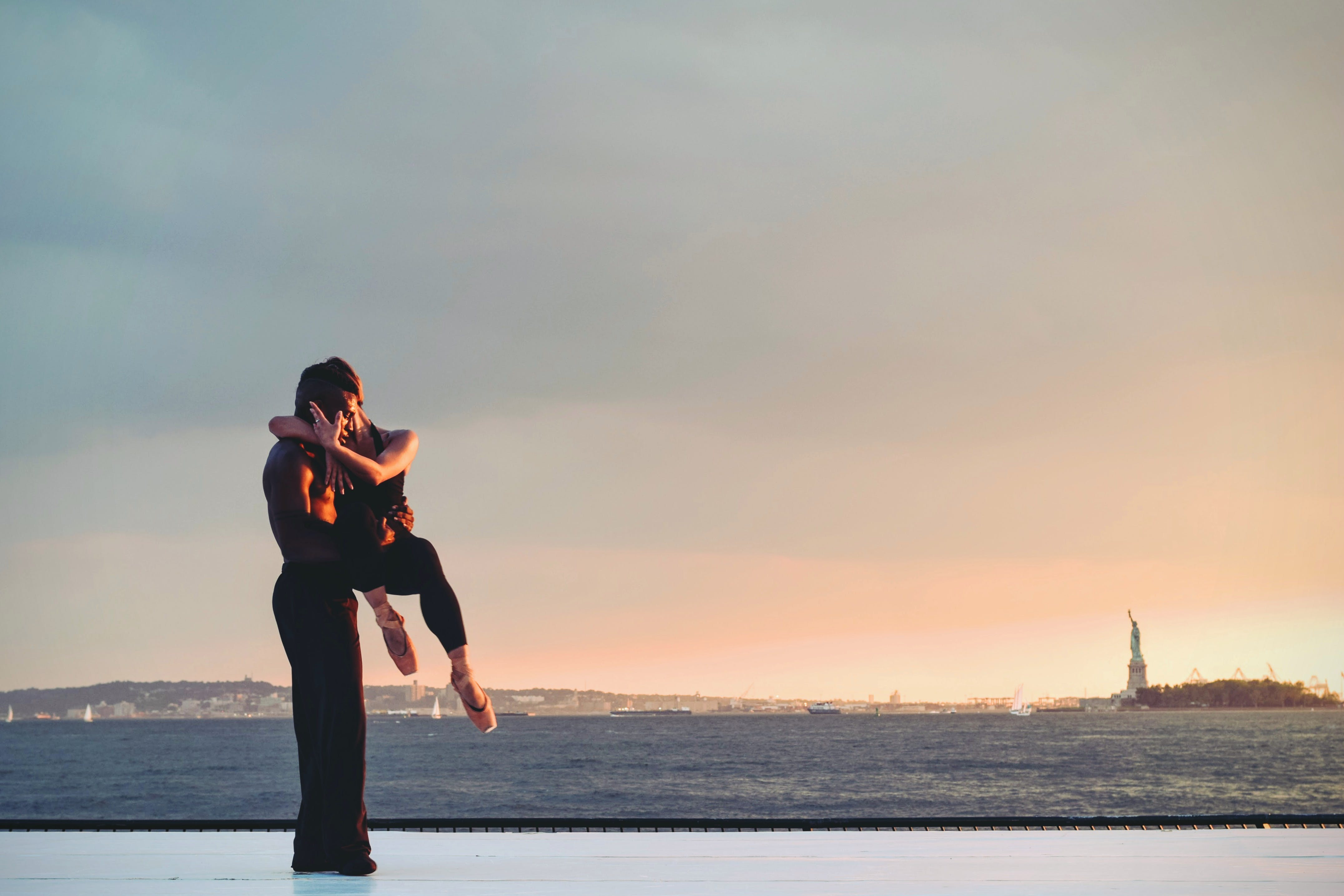 Man Carrying Woman Standing on Beachside