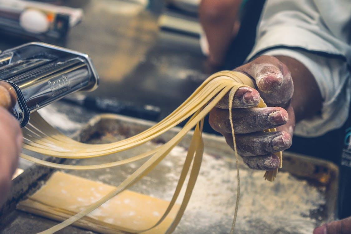 Person Making Pasta Tagliatelle