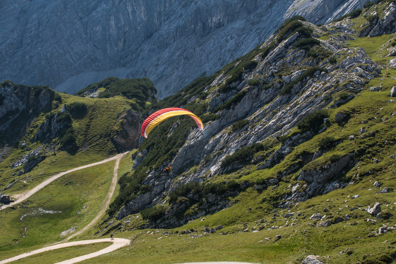 Person Parasailing Near the Mountain