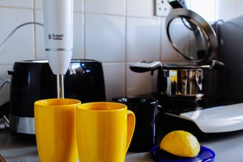 Ingyenes stockfotó két sárga kávéscsésze témában