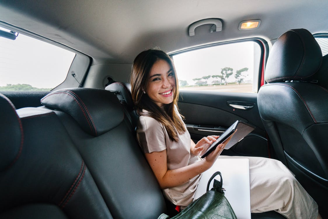 Smiling Woman Sitting Inside Car