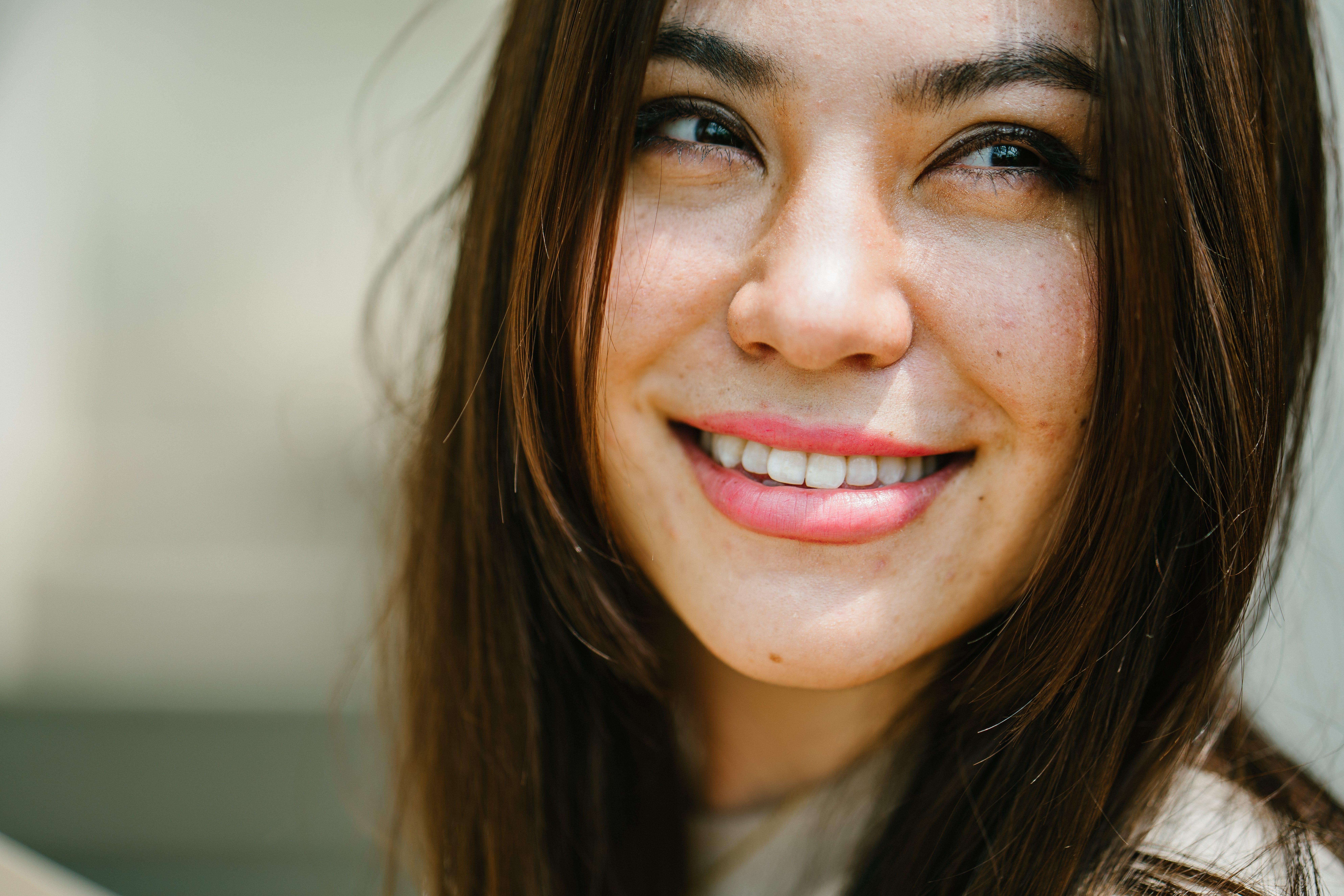 Smiling Woman Wearing White Top
