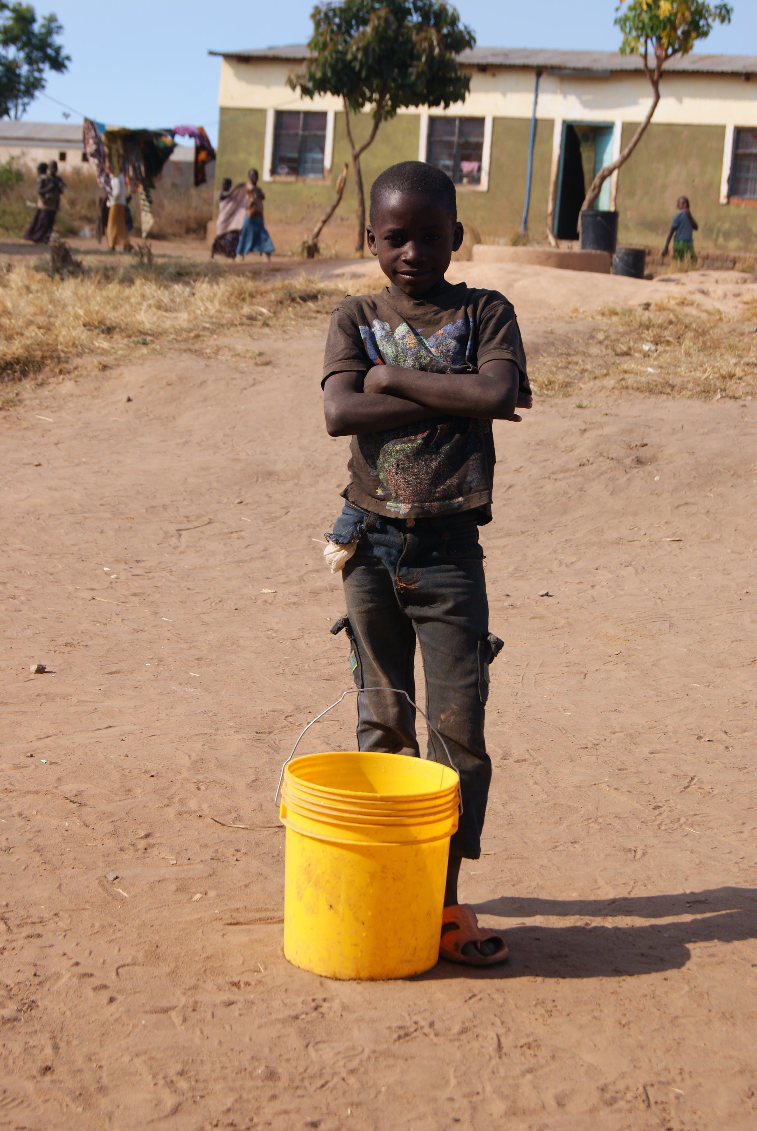 Free stock photo of africa, boy, bucket, sand