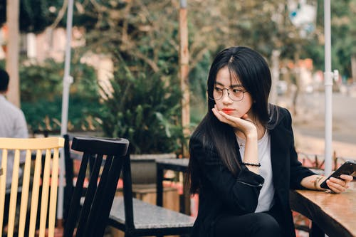 Woman Sitting on Black Chair