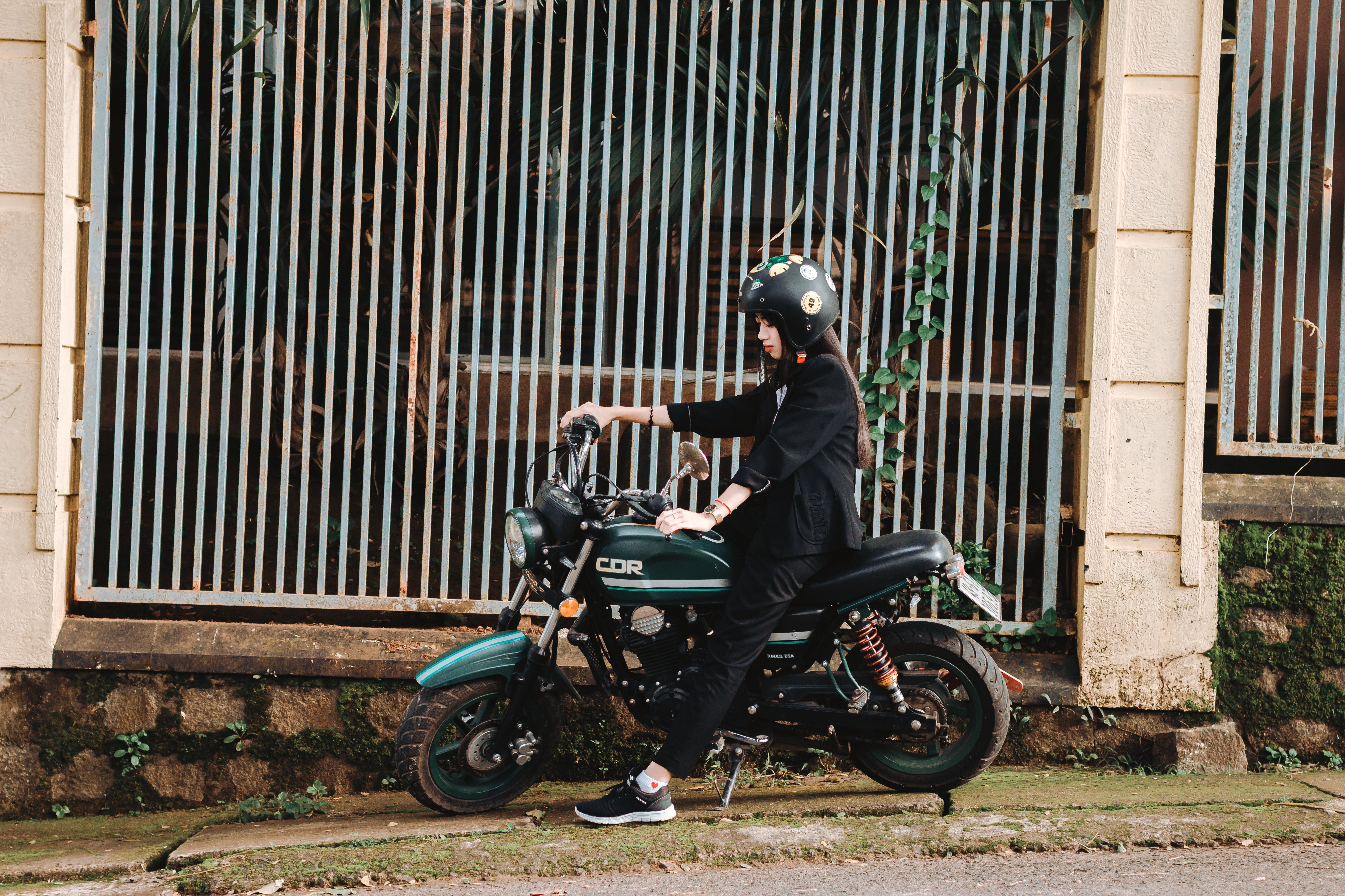 Woman Riding on Green Motorcycle