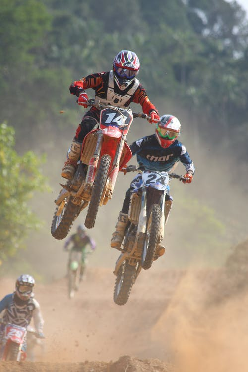 Two People Riding on Dirt Bike