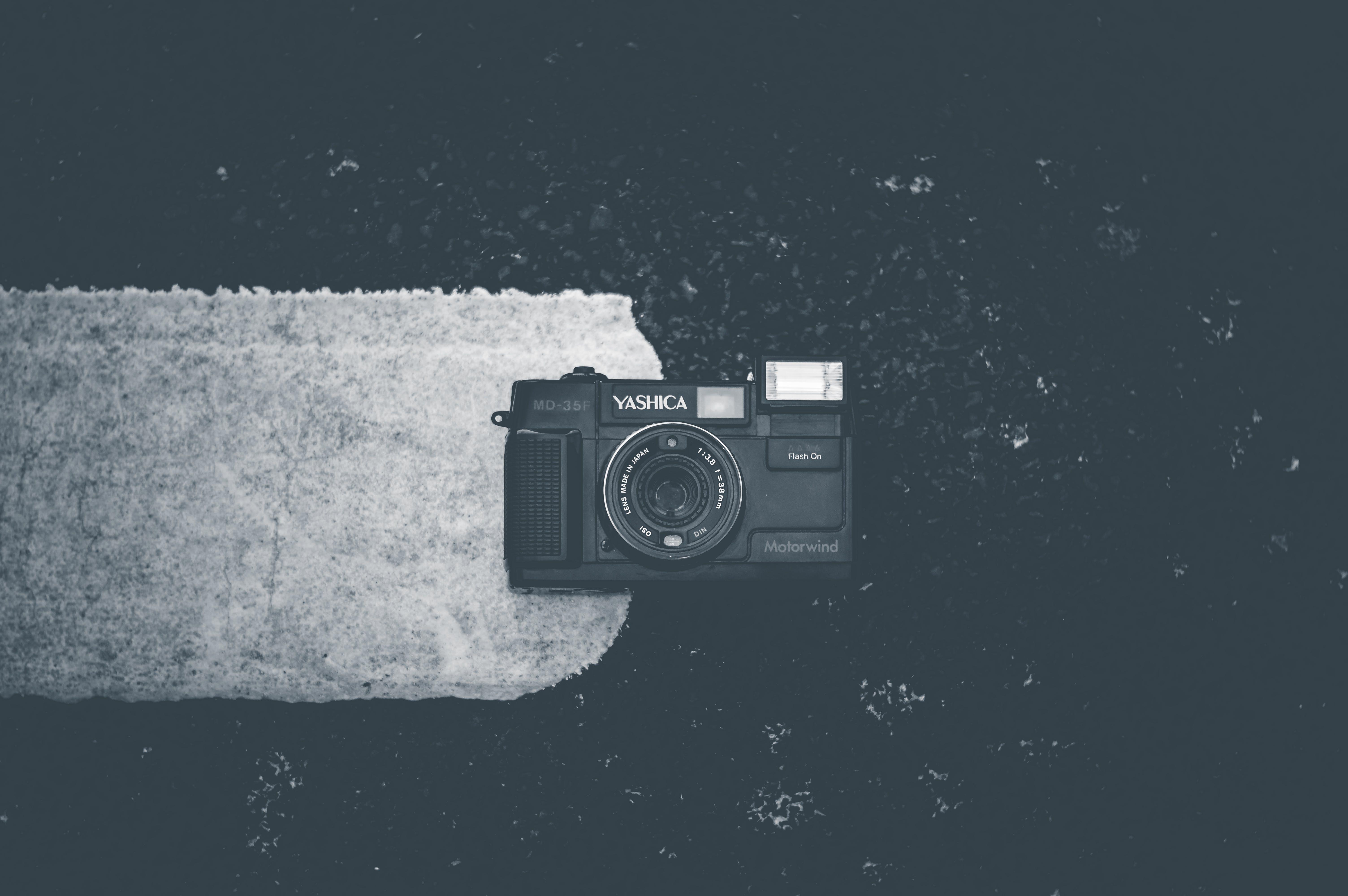 Blakc Camera on White Textile