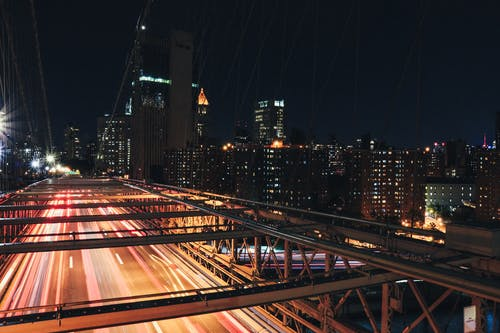 Time Lapse Photography of Bridge at Nighttime